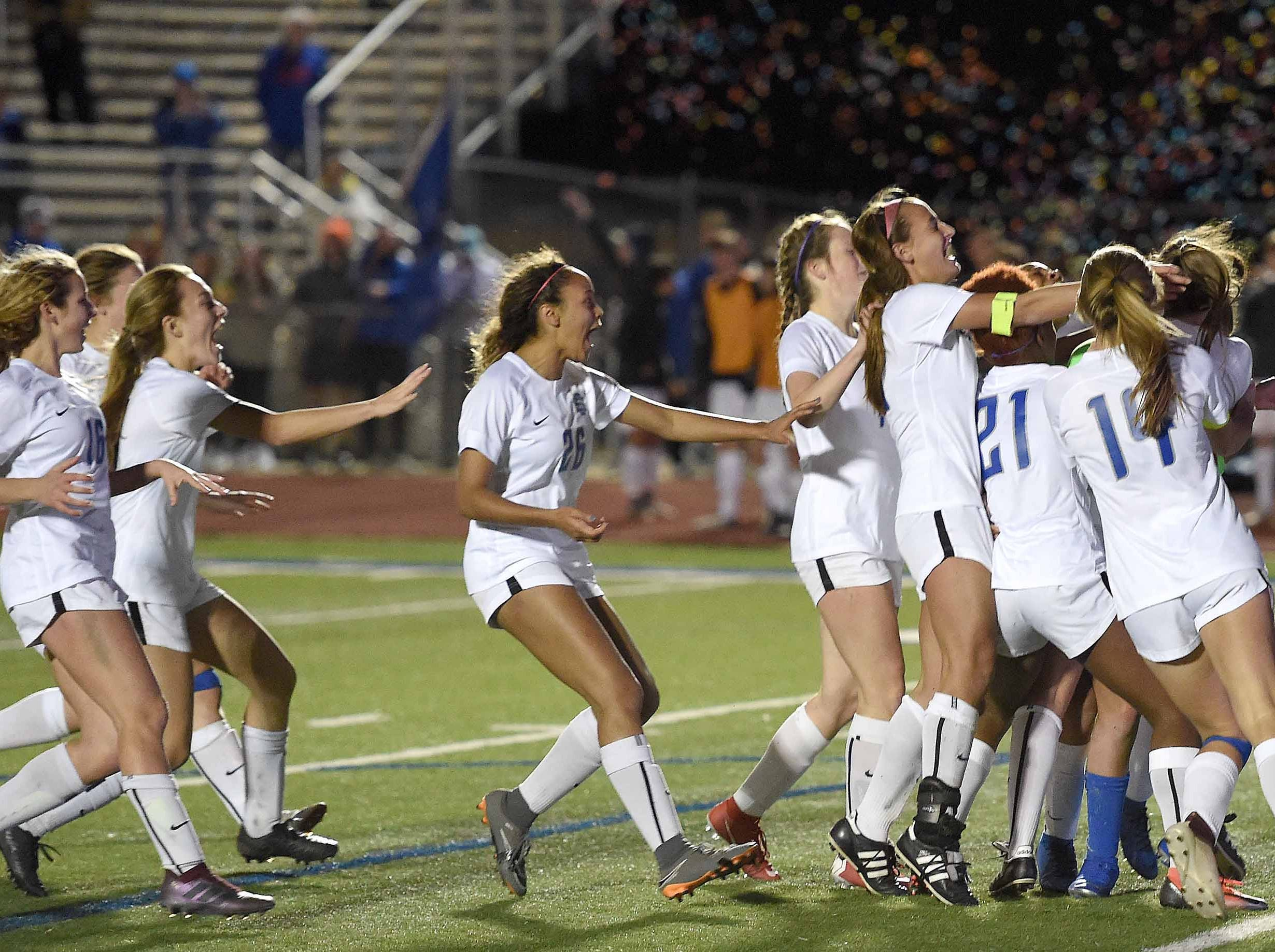 The Ocean Springs Lady Greyhounds run to Jackie Dilorenzo, who made the winning penalty kick, and goalkeeper A'leigh Coleman after beating Madison Central 1-0 on penalty kicks after overtime periods in the Class 6A championship in the MHSAA BlueCross Blue Shield of Mississippi Soccer Classic on Saturday, February 9, 2019, at Ridgeland High School in Ridgeland, Miss.