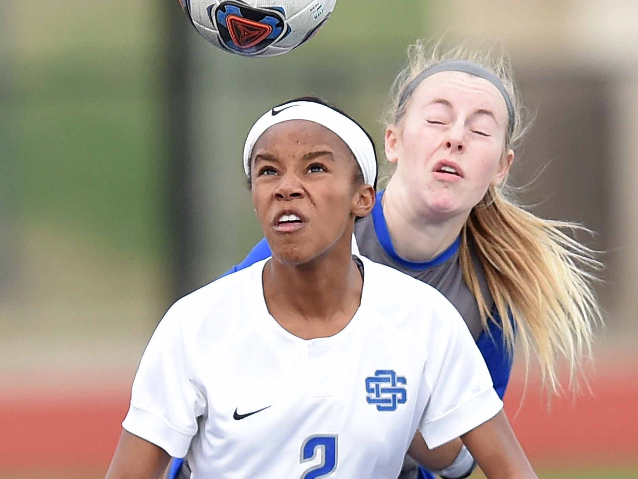 Ocean Springs' Kinsley Harmon (2) boxes out a Madison Central Lady Jaguar for a header in the Class 6A state championship in the MHSAA BlueCross Blue Shield of Mississippi Soccer Classic on Saturday, February 9, 2019, at Ridgeland High School in Ridgeland, Miss.