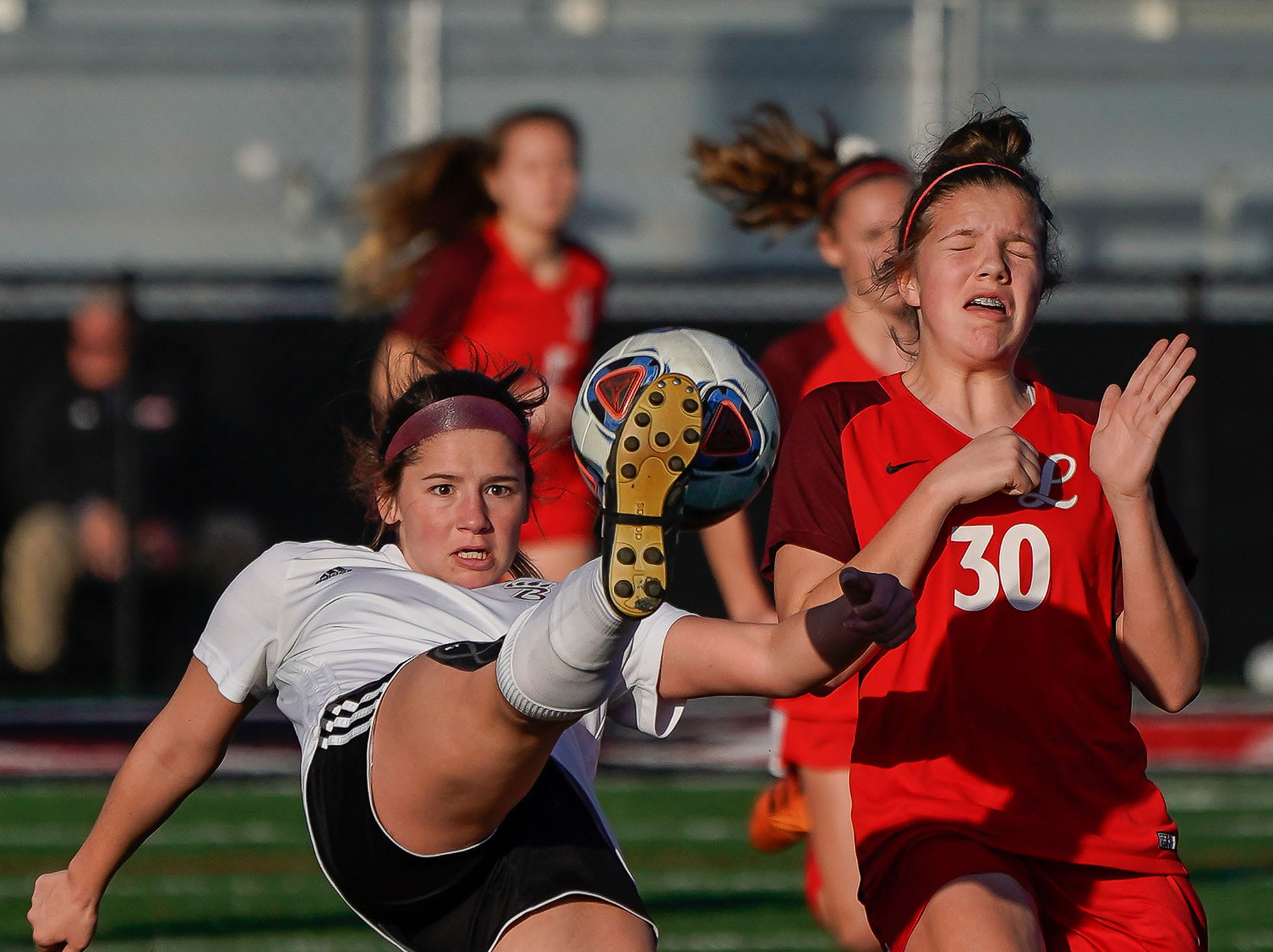 Long Beach's Alexa Beets (6) high kicks a ball against Lafayette's Lucy Wilson (3) during the MHSAA 5A Girls Soccer Championships held at Brandon High School in Brandon, MS, Saturday February 9, 2019.(Bob Smith-For The Clarion Ledger)
