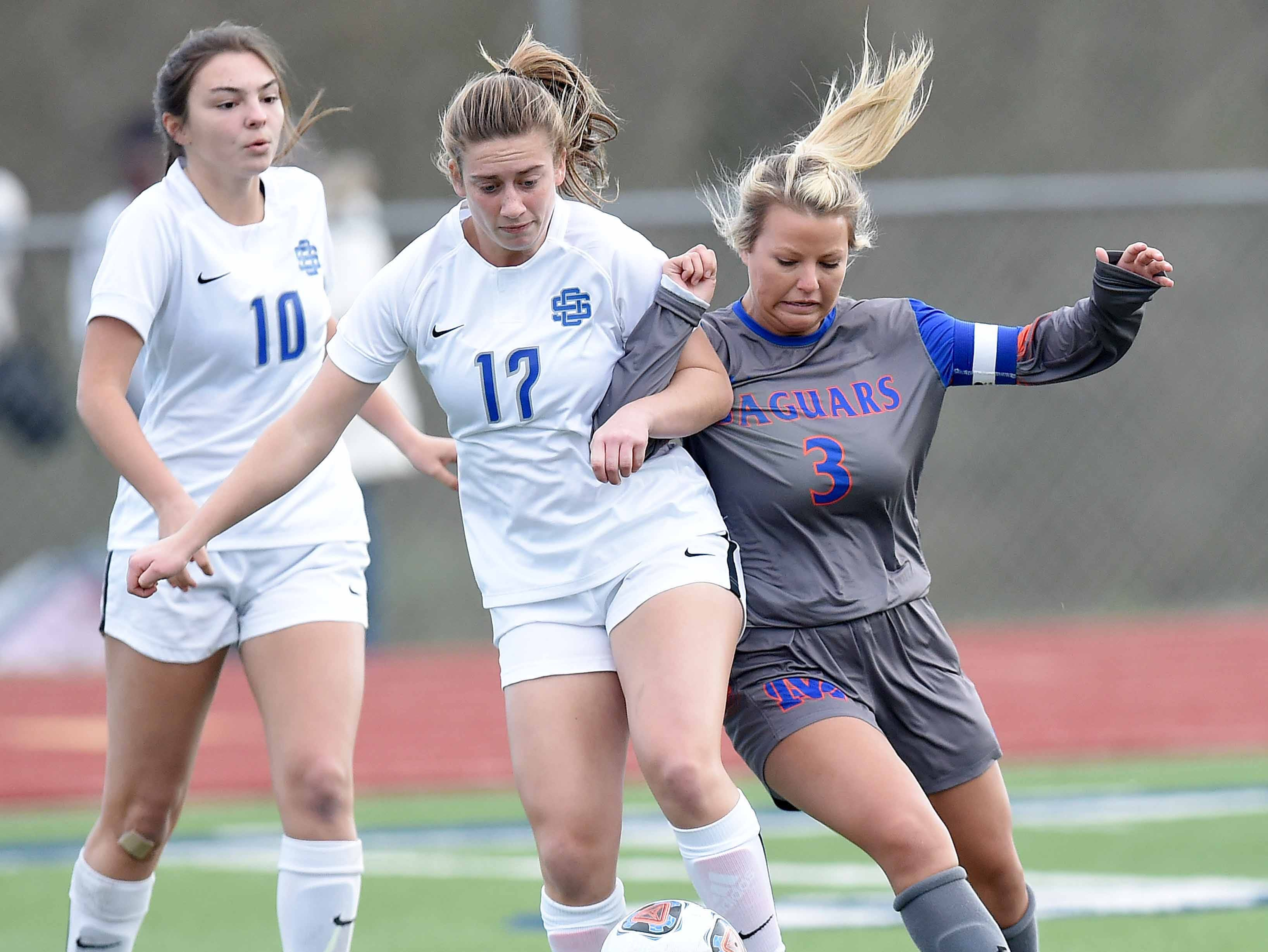 Ocean Springs' Mallory Bellon (17) and Madison Central's Cady Lloyd (3) compete for a loose ball in the Class 6A state championship in the MHSAA BlueCross Blue Shield of Mississippi Soccer Classic on Saturday, February 9, 2019, at Ridgeland High School in Ridgeland, Miss.