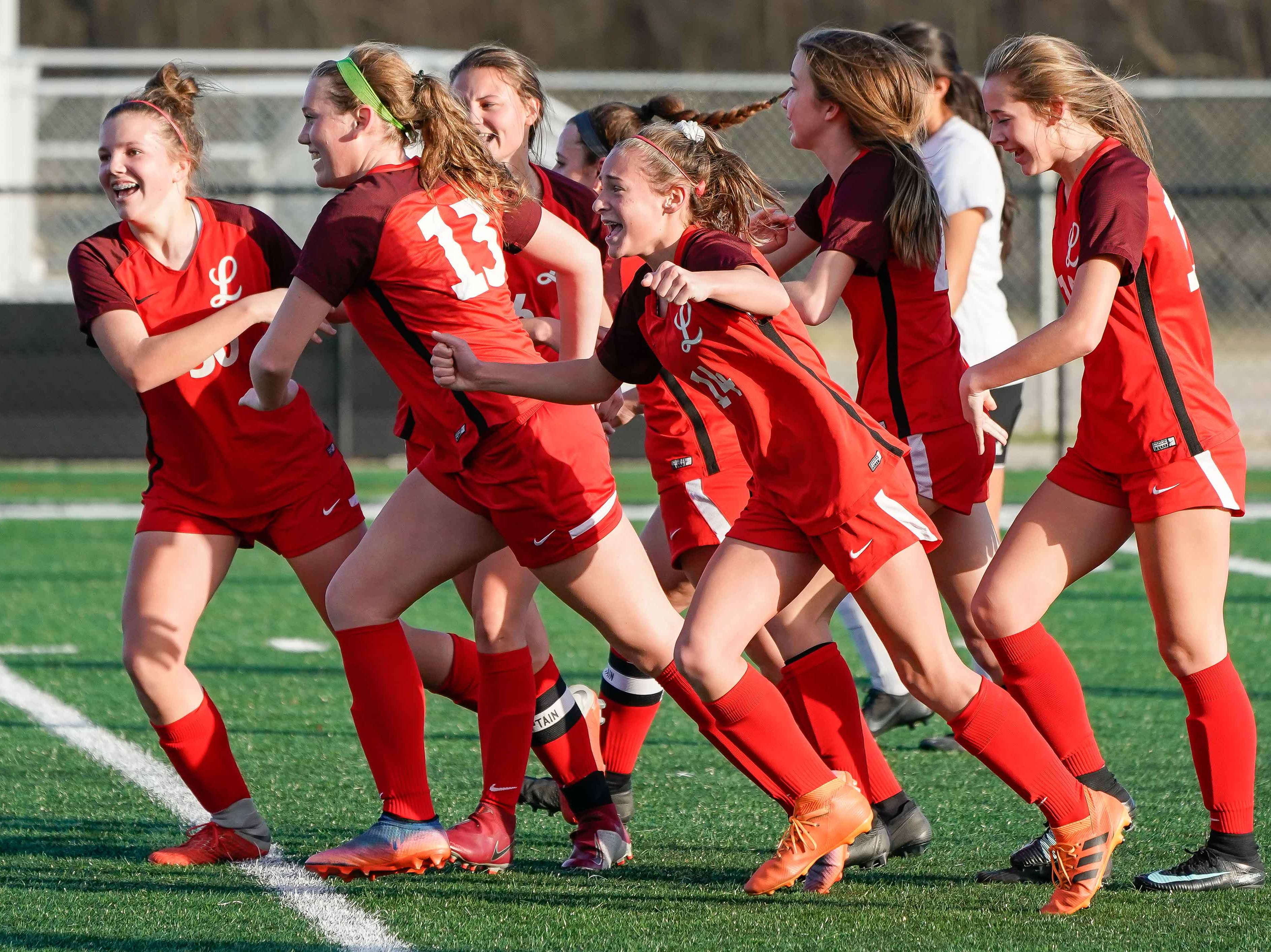 Lafayette girls celebrate a first period goal against Long Beach during the MHSAA 5A Girls Soccer Championships held at Brandon High School in Brandon, MS, Saturday February 9, 2019.(Bob Smith-For The Clarion Ledger)
