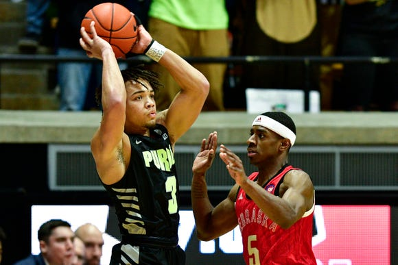 Feb 9, 2019; West Lafayette, IN, USA; Purdue Boilermakers guard Eric Hunter Jr. (2) looks for an open teammate against Nebraska Cornhuskers guard Glynn Watson Jr. (5) during the first half of the game at Mackey Arena. Mandatory Credit: Marc Lebryk-USA TODAY Sports