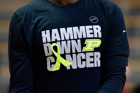 Feb 9, 2019; West Lafayette, IN, USA; The Purdue Boilermakers wear special Hammer down Cancer shirts during warmups before the game against the Nebraska Cornhuskers at Mackey Arena. Mandatory Credit: Marc Lebryk-USA TODAY Sports