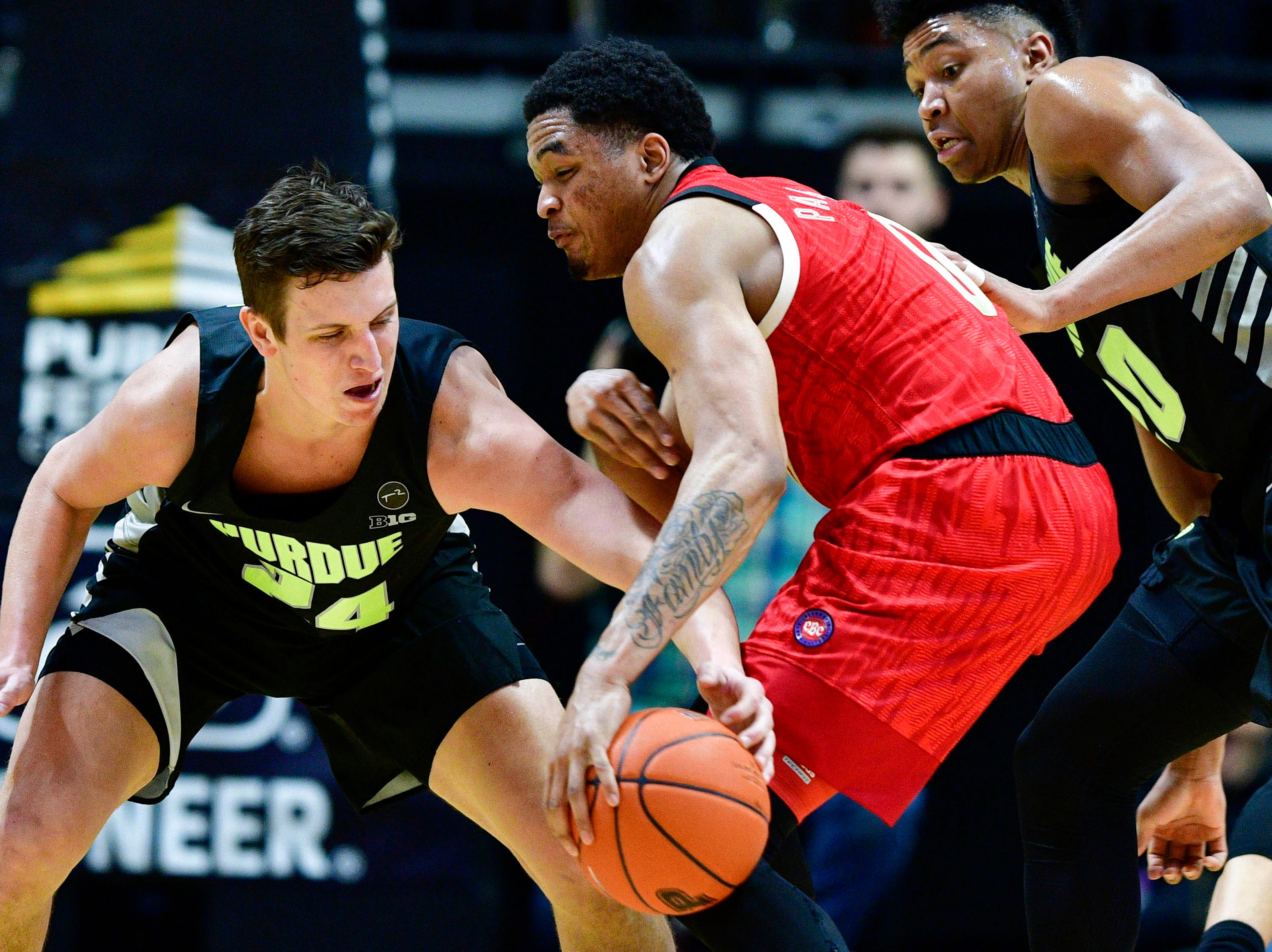 Feb 9, 2019; West Lafayette, IN, USA; Purdue Boilermakers forward Grady Eifert (24) steals a ball from Nebraska Cornhuskers guard James Palmer Jr. (0) during the second half of the game at Mackey Arena. The Purdue Boilermakers defeated the Nebraska Cornhuskers 81 to 62.  Mandatory Credit: Marc Lebryk-USA TODAY Sports
