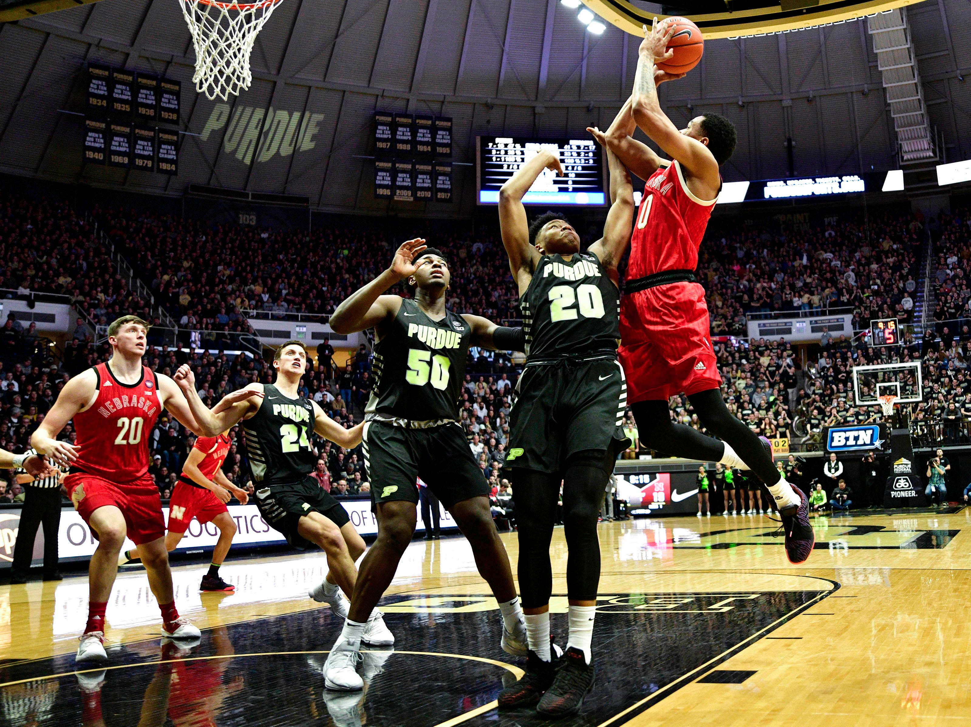 Feb 9, 2019; West Lafayette, IN, USA; Nebraska Cornhuskers guard James Palmer Jr. (0) attempts a shot over Purdue Boilermakers guard Nojel Eastern (20) and Purdue Boilermakers forward Trevion Williams (50) during the first half of the game at Mackey Arena. Mandatory Credit: Marc Lebryk-USA TODAY Sports