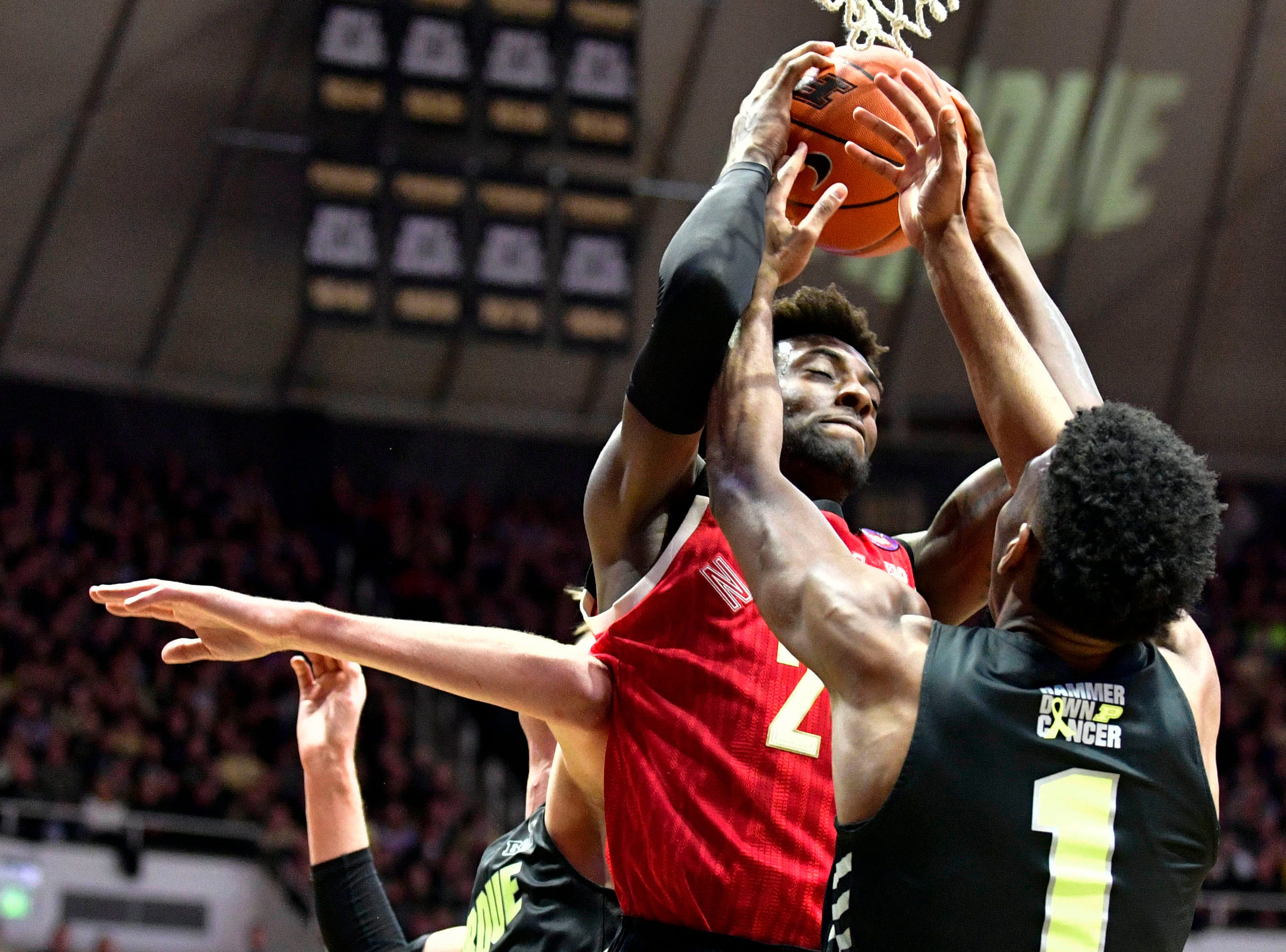Feb 9, 2019; West Lafayette, IN, USA; Nebraska Cornhuskers guard Nana Akenten (25) fights for a rebound against Purdue Boilermakers forward Aaron Wheeler (1) during the first half of the game at Mackey Arena. Mandatory Credit: Marc Lebryk-USA TODAY Sports
