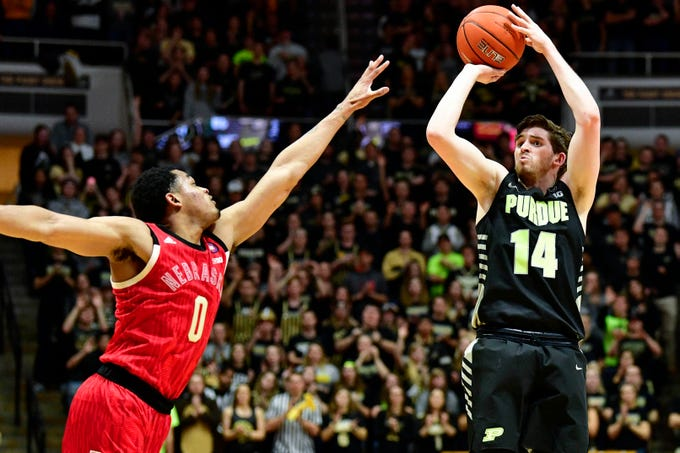 Feb 9, 2019; West Lafayette, IN, USA; Purdue Boilermakers guard Ryan Cline (14) takes a shot over Nebraska Cornhuskers guard James Palmer Jr. (0) during the second half of the game at Mackey Arena. The Purdue Boilermakers defeated the Nebraska Cornhuskers 81 to 62.  Mandatory Credit: Marc Lebryk-USA TODAY Sports