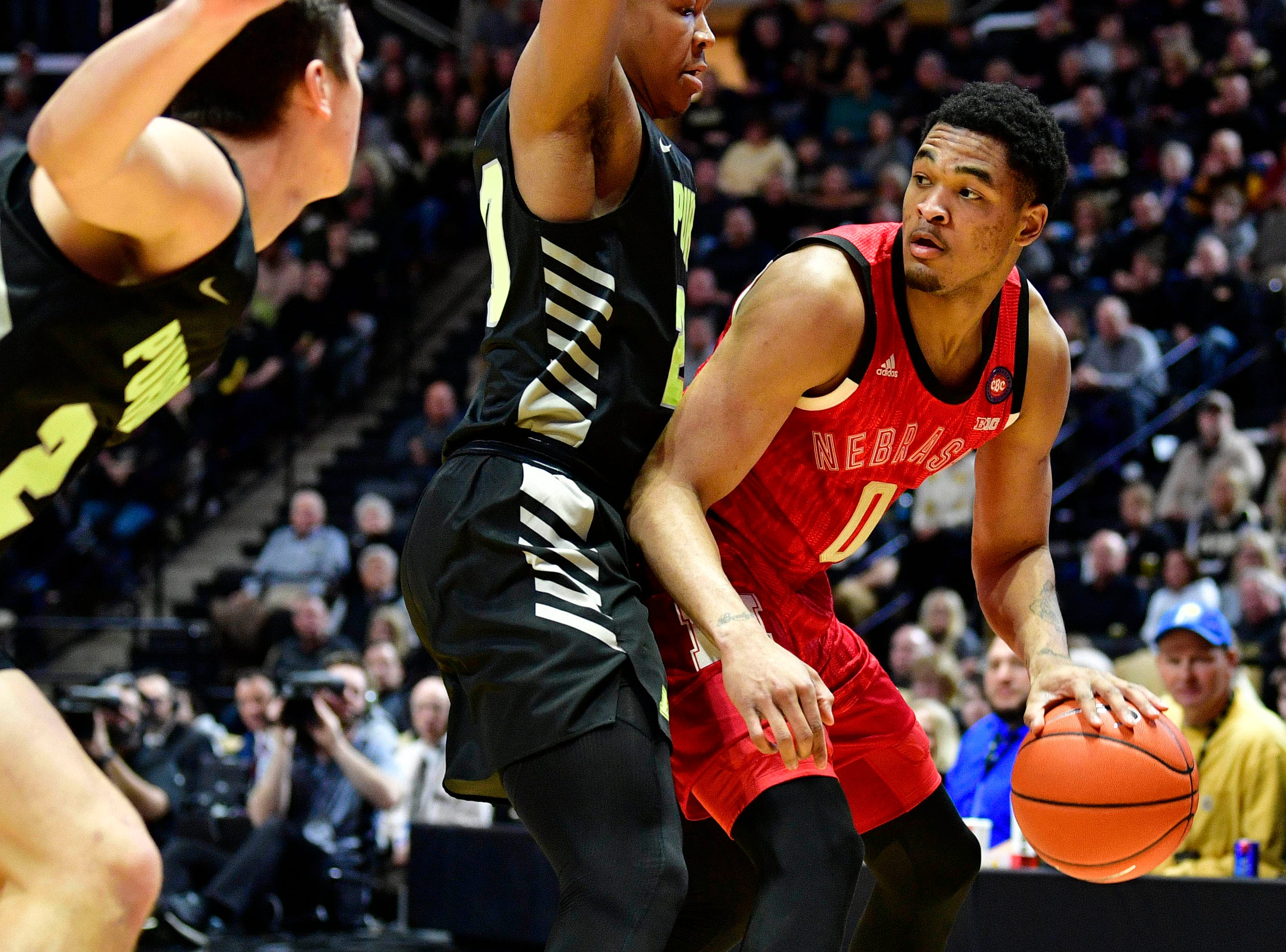 Feb 9, 2019; West Lafayette, IN, USA; Nebraska Cornhuskers guard James Palmer Jr. (0) attempts to keep the ball away from Purdue Boilermakers guard Nojel Eastern (20) during the first half of the game at Mackey Arena. Mandatory Credit: Marc Lebryk-USA TODAY Sports