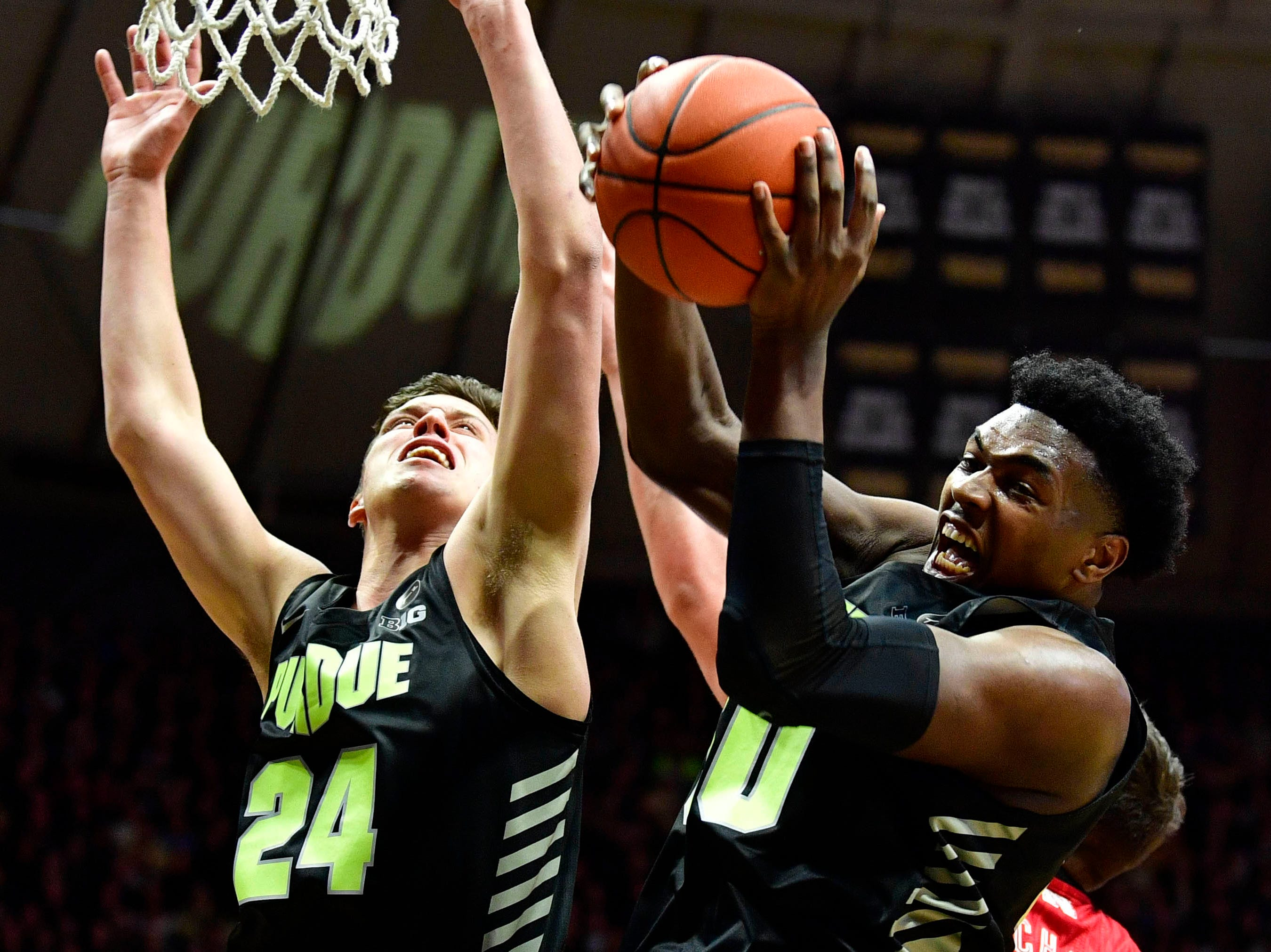 Purdue Boilermakers forward Trevion Williams (50) grabs a rebound after a shot by the Nebraska Cornhuskers during the first half of the game at Mackey Arena.