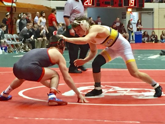 Lancaster freshman Aiden Agin wrestled in the 120-pound weight class against La Salle during Sunday's state dual team tournament at Ohio State's St. John Arena.