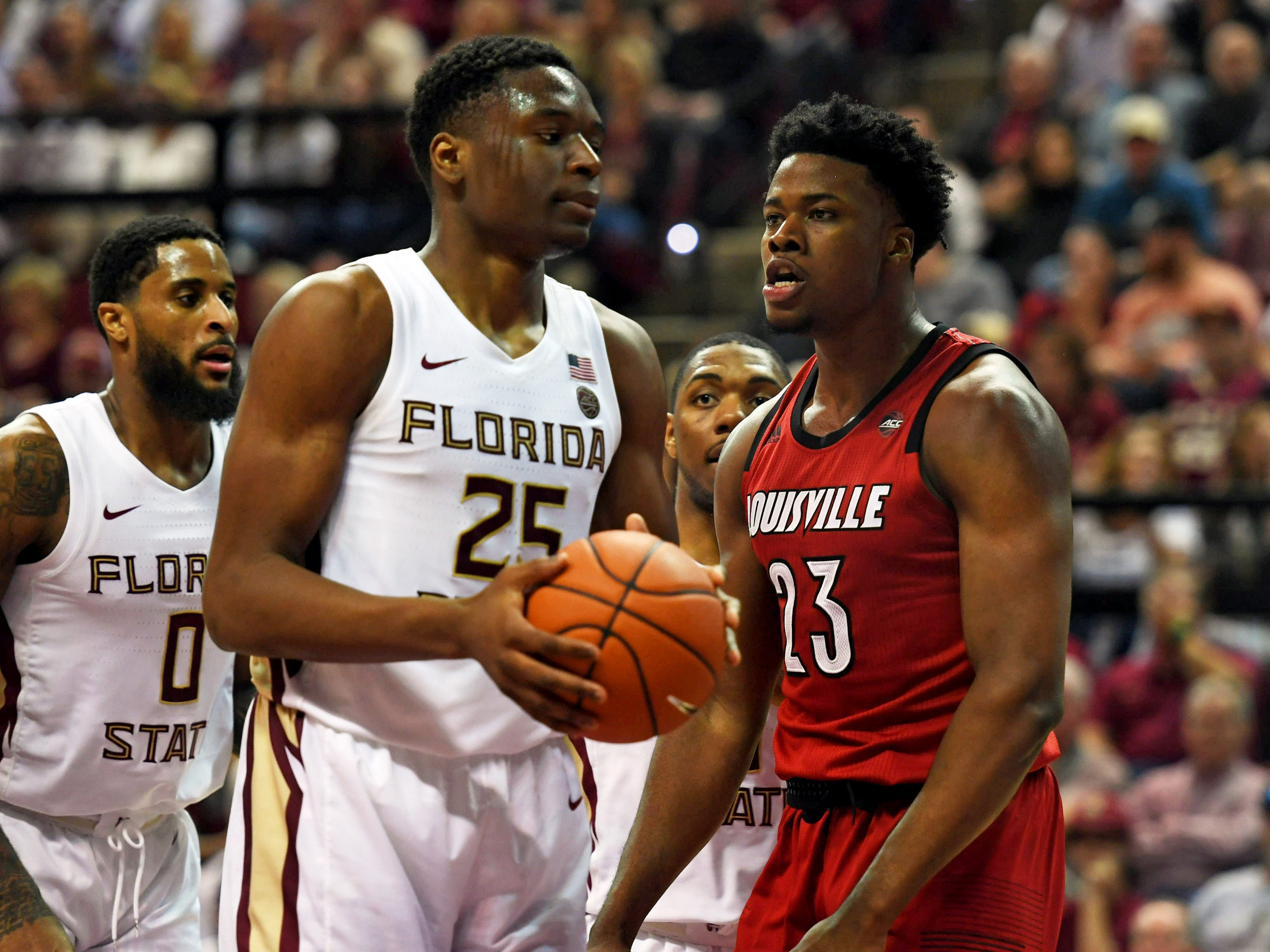 Louisville Cardinals center Steven Enoch (23) receives a technical foul as he gets in the face of Florida State Seminoles forward Mfiondu Kabengele (25) during the second half at Donald L. Tucker Center in Tallahassee, Florida, on Saturday, Feb. 9, 2019.