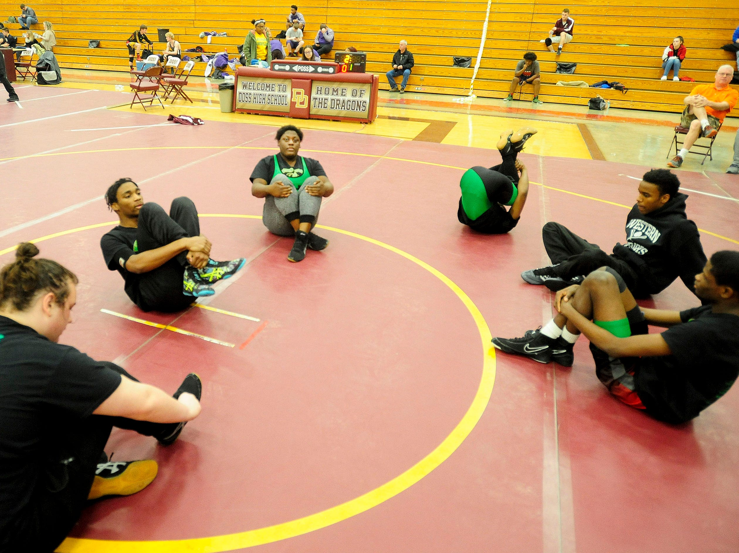 Western wrestler Malasha Lokey, top center, warms up with her teammates at a KHSAA Region 3 wrestling meet at Doss.