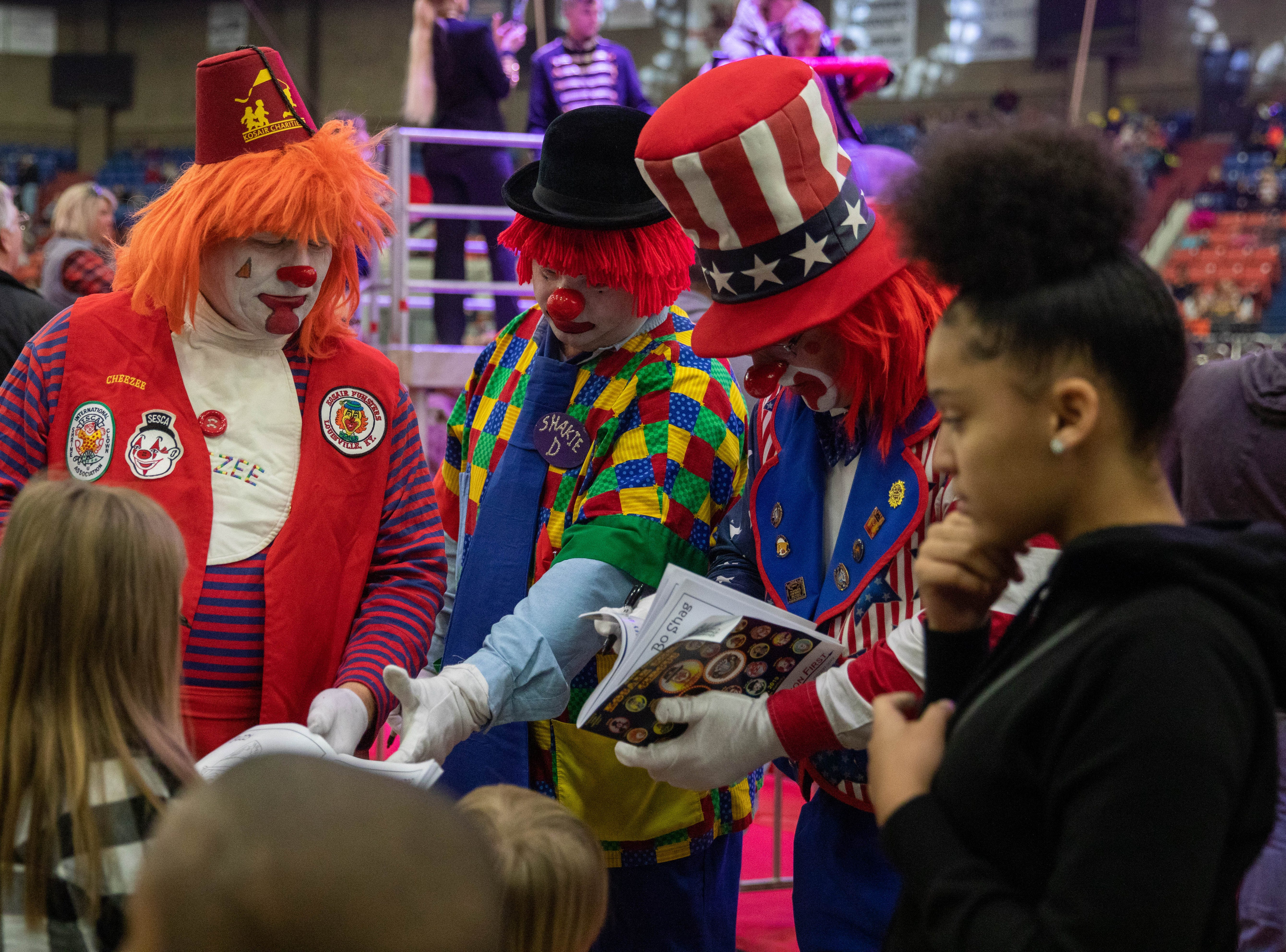 Clowns sign autographs during intermission of the Kosair Shrine Circus, Saturday, Feb. 9, 2019 in Louisville Ky.