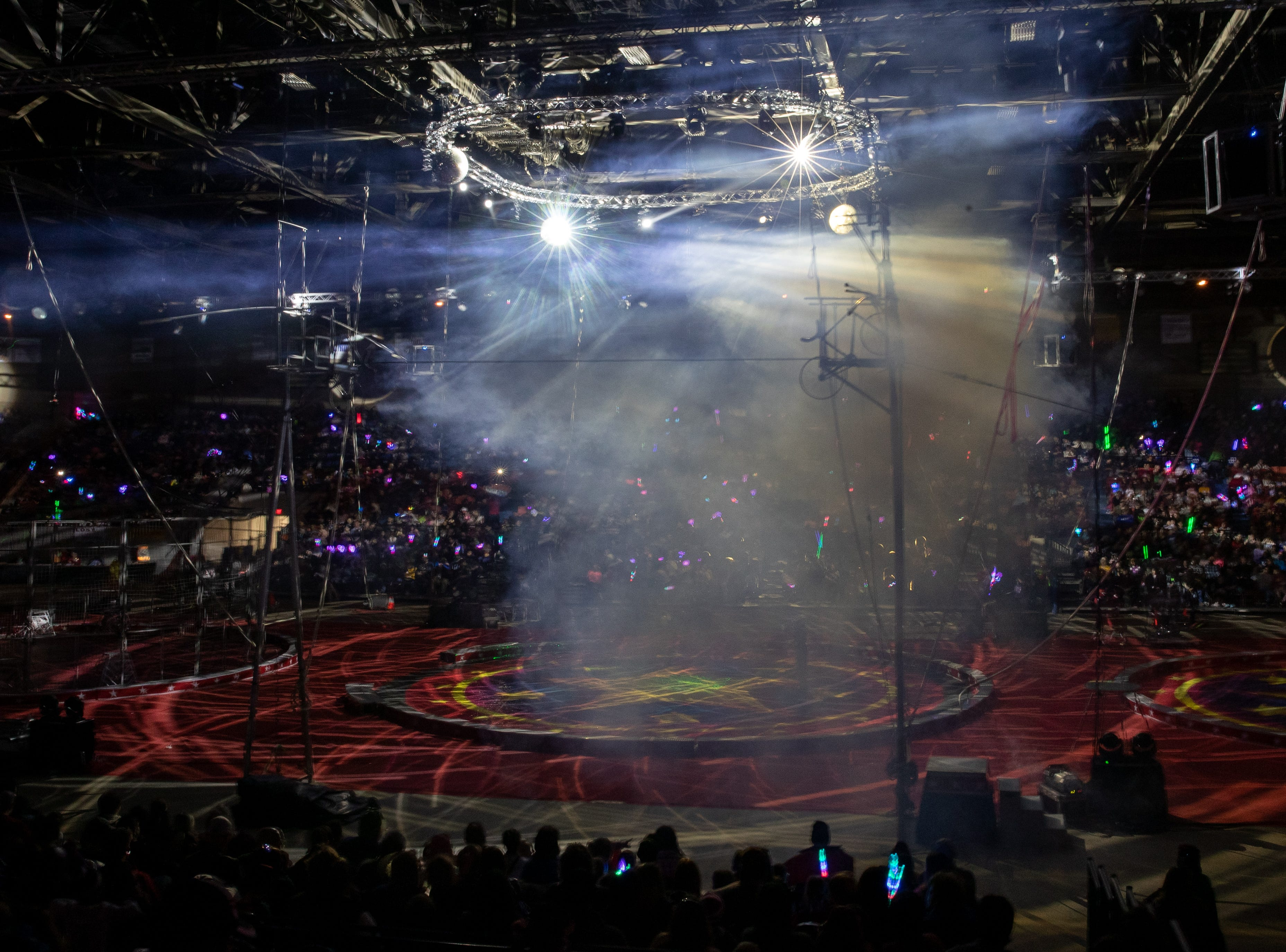 Swinging lights, disco balls, smoke and music fill Broadbent arena to signal the start of the Kosair Shrine Circus, Saturday, Feb. 9, 2019 in Louisville Ky.