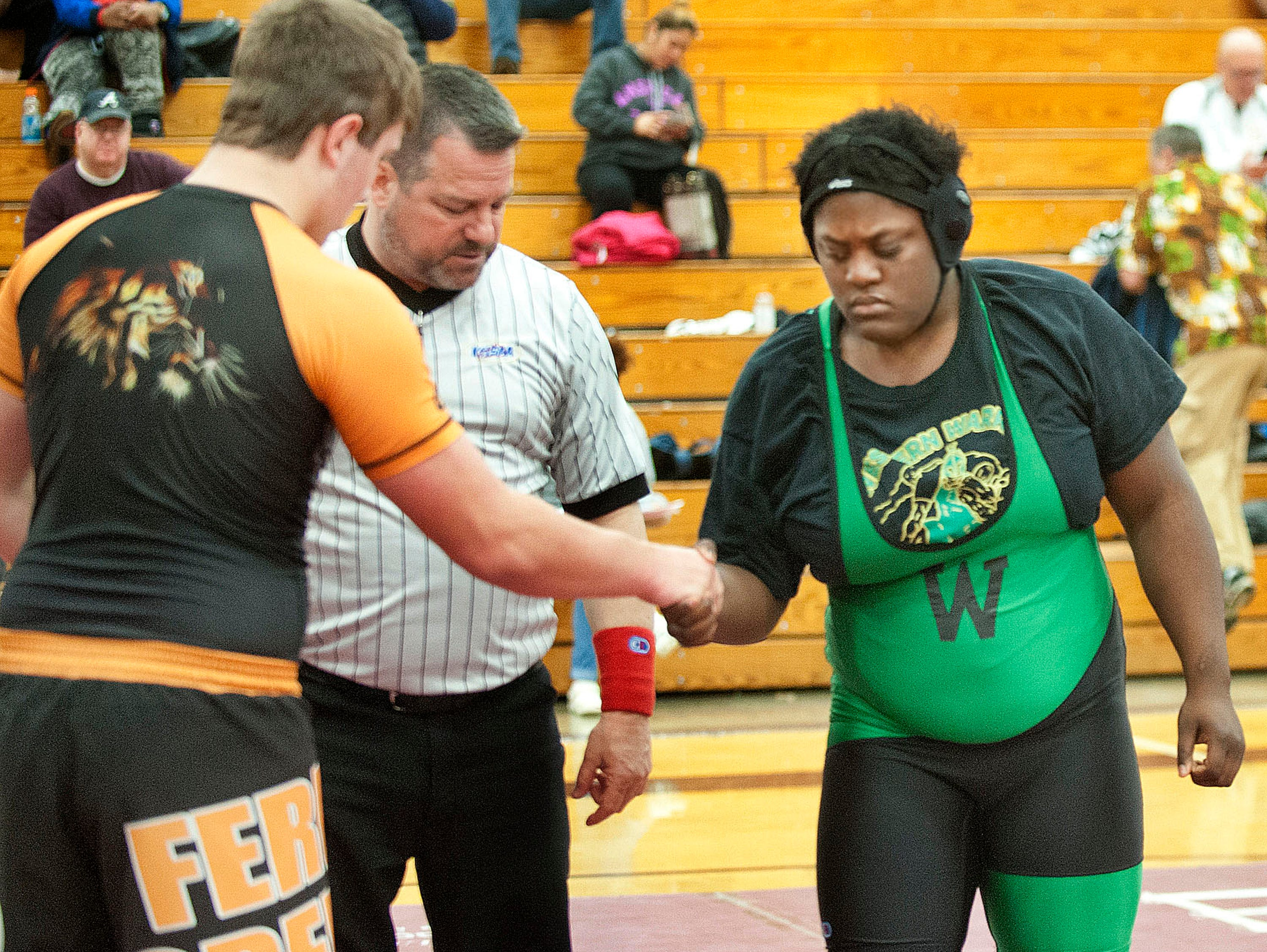 After pinning Lokey, Fern Creek's Alex Martin shakes her hand.
