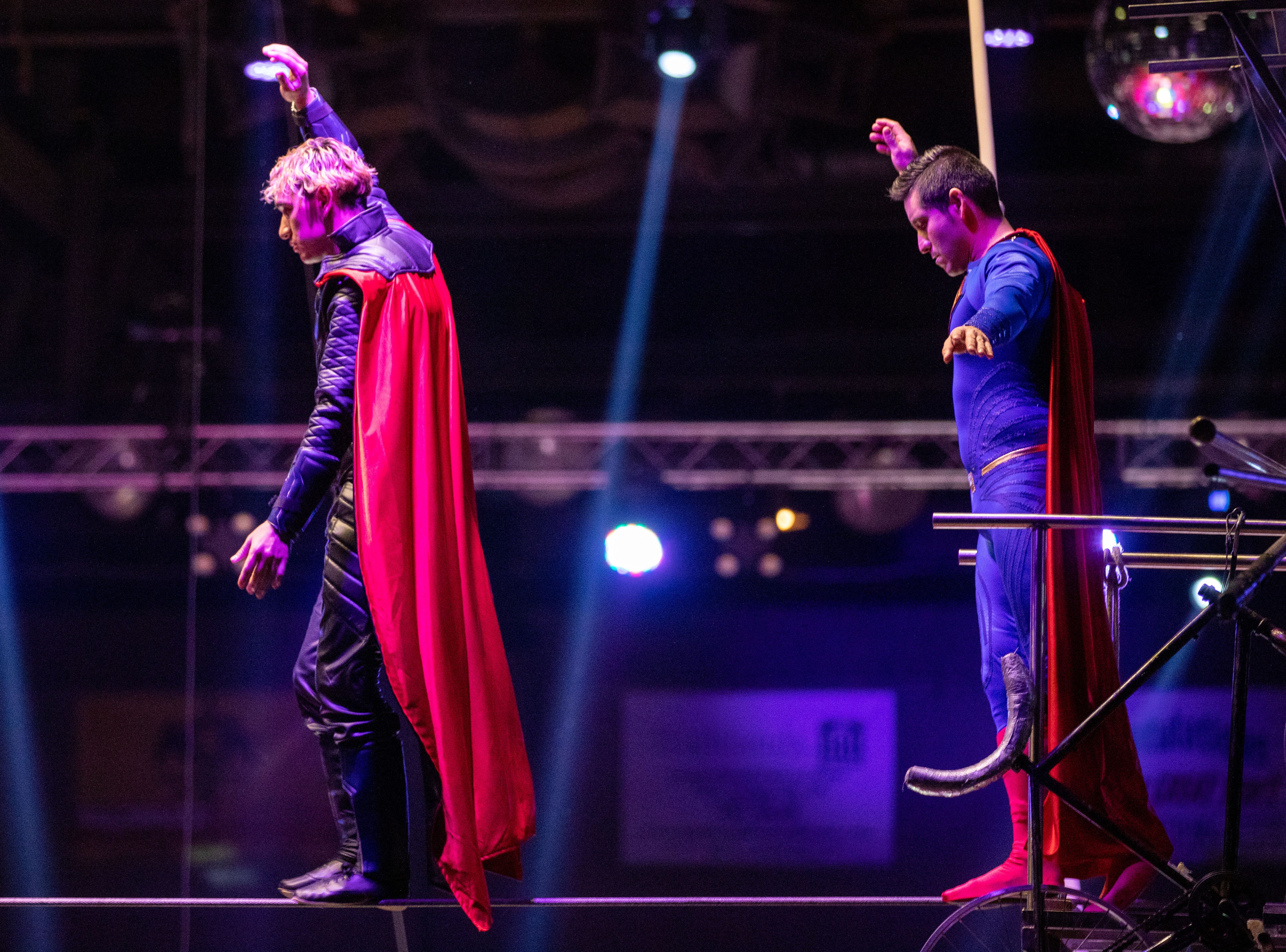 Performers walk the tightrope in superhero costumes to open the Kosair Circus, Saturday, Feb. 9, 2019 in Louisville Ky.