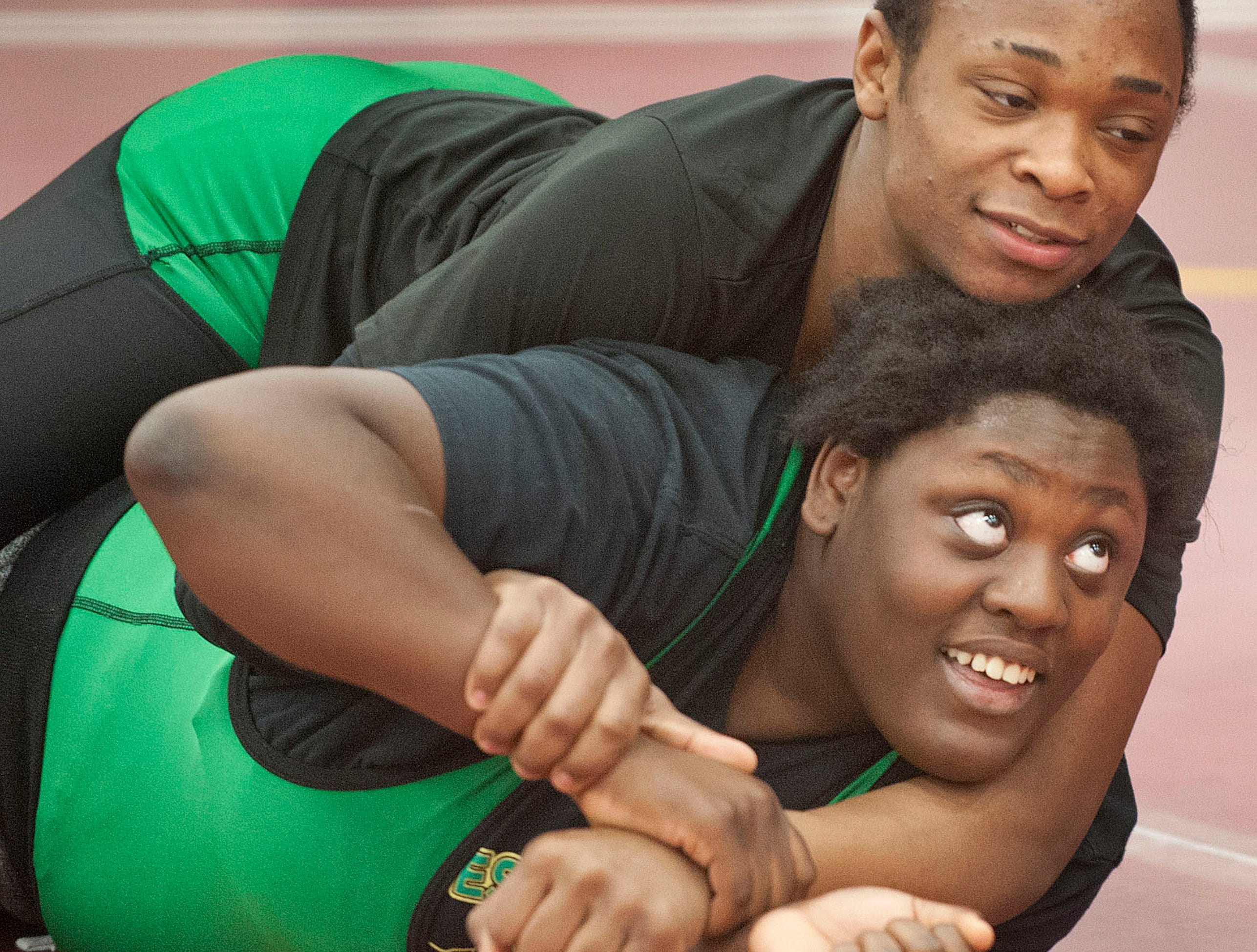 Western wrestler Malasha Lokey and her warm-up partner, Lee'Shion Stroud, wrestle during warm-ups prior to the start of the KHSAA Region 3.09 February 2019