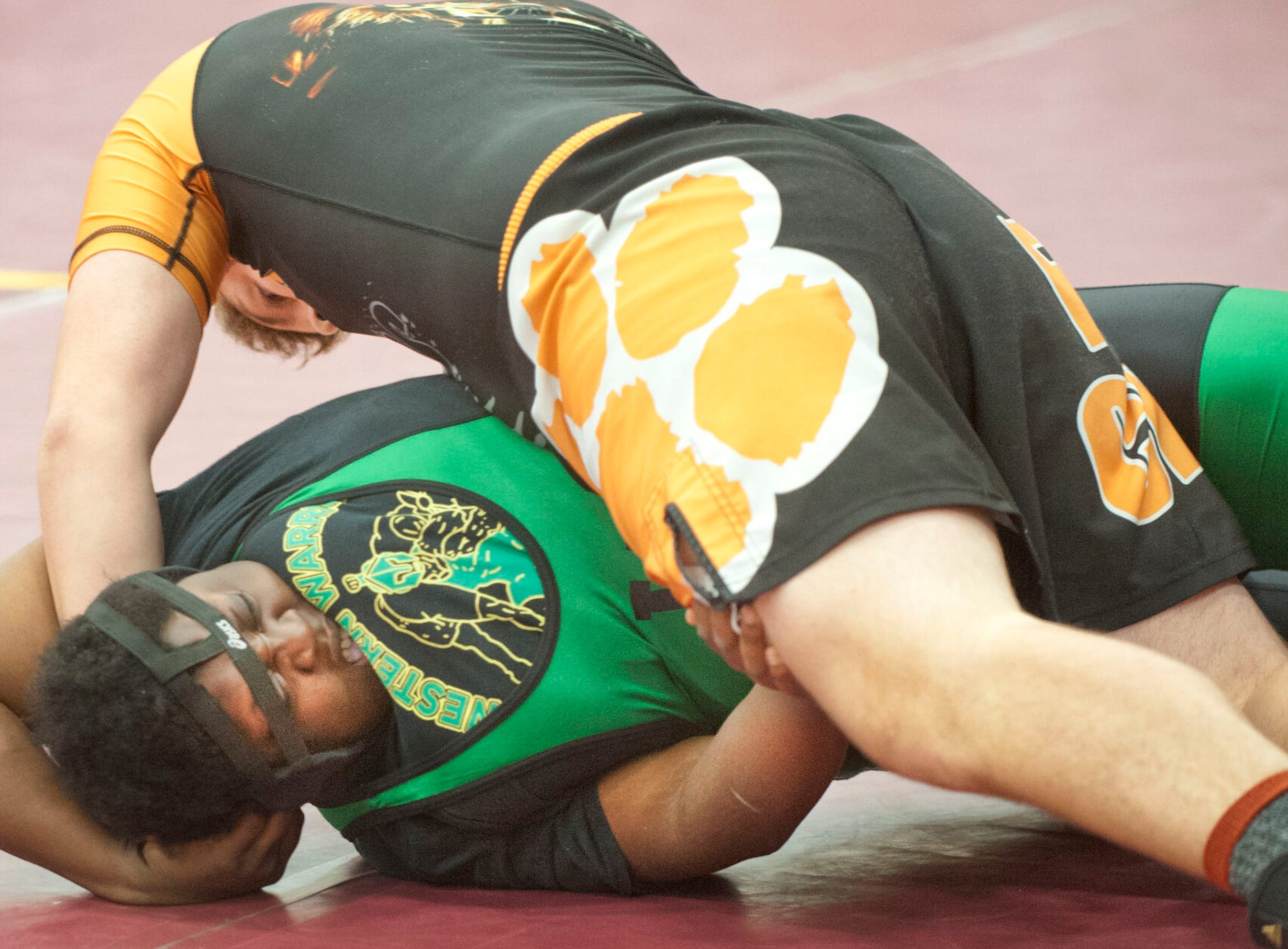 Fern Creek's Alex Martin almost has Lokey pinned as she fights to get out of the situation.09 February 2019