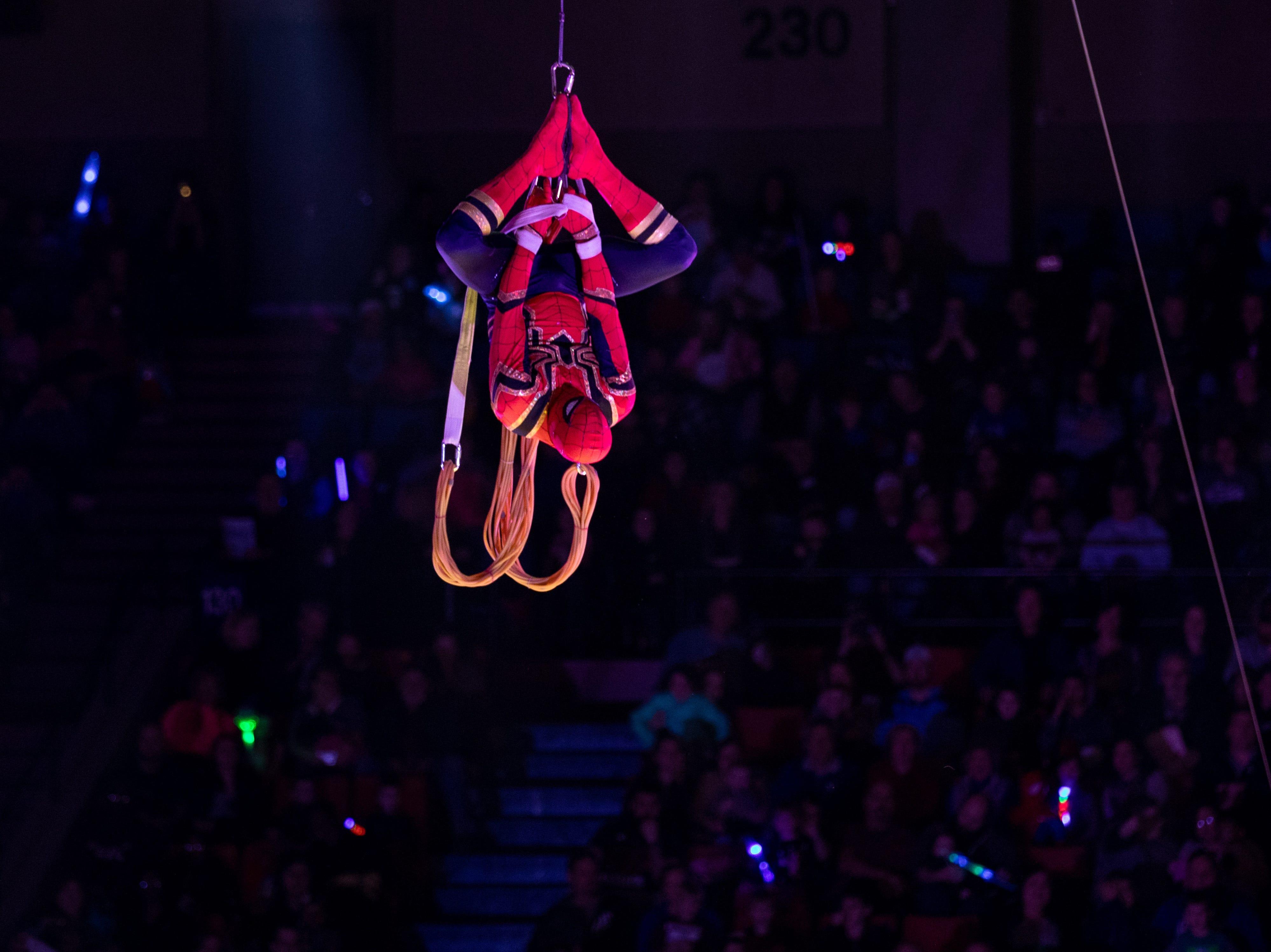 Spiderman swings in upside down to open the Kosair Circus, Saturday, Feb. 9, 2019 in Louisville Ky.