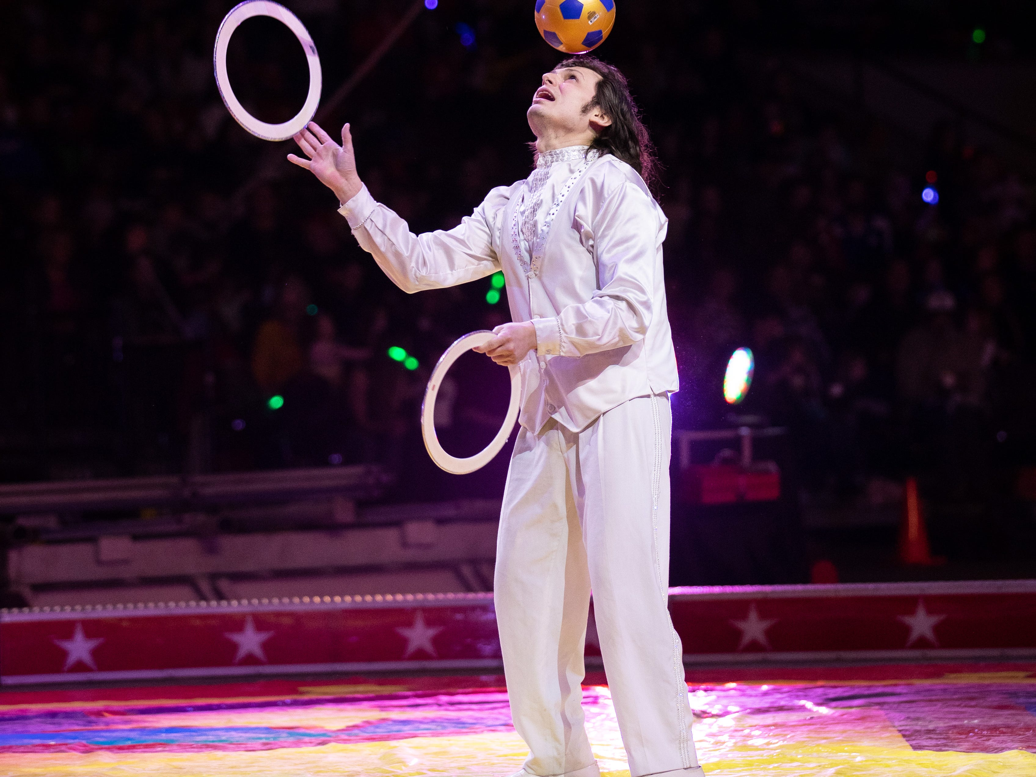 A juggler in the center ring tosses rings high in the air while also juggling a soccer ball on his head at the Kosair Shrine Circus, Saturday, Feb. 9, 2019 in Louisville Ky.