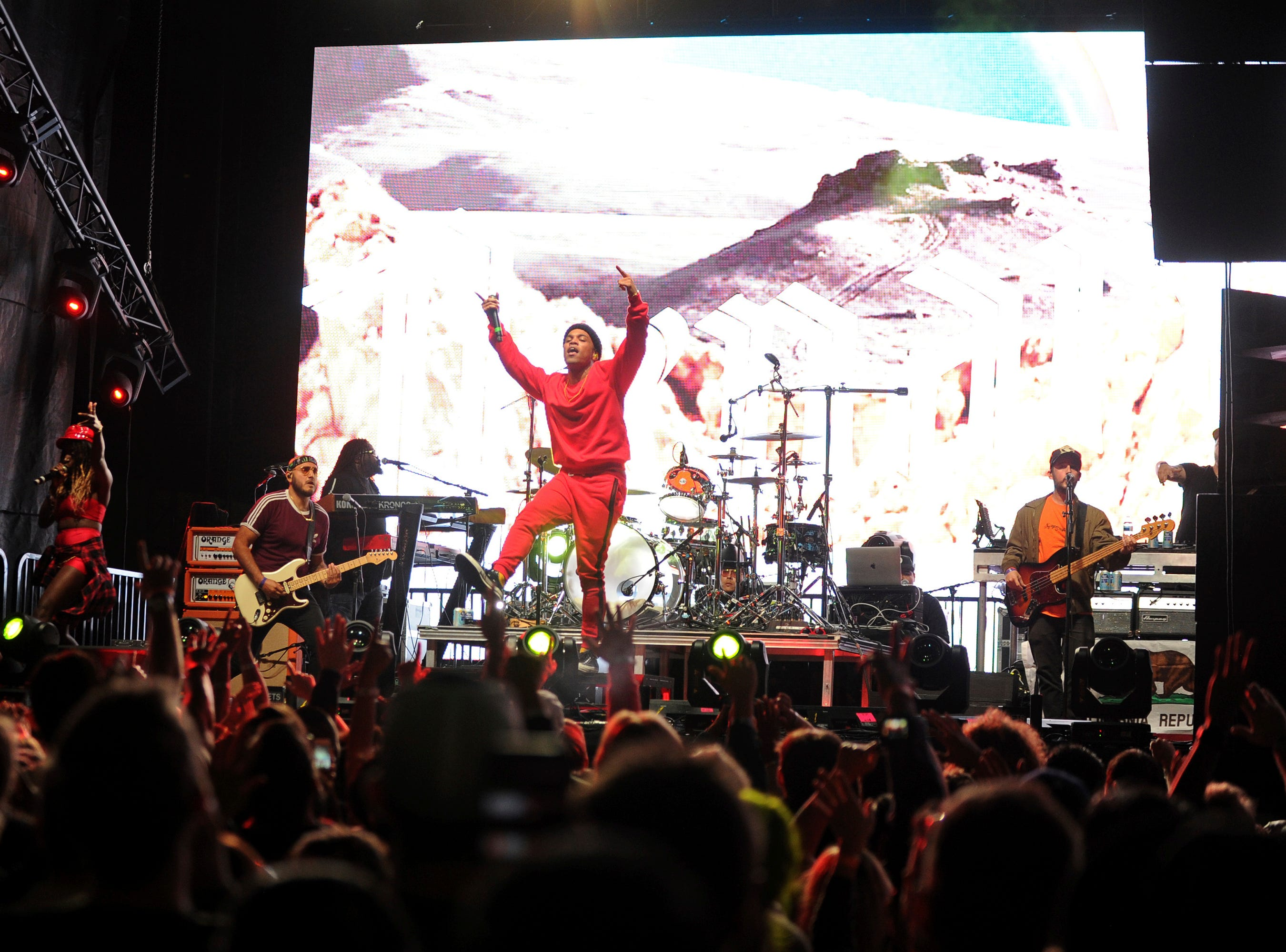 IMAGE DISTRIBUTED FOR GUITAR CENTER - Anderson .Paak performs at Guitar Center's reimagined Hollywood flagship store on Saturday, Nov. 3, 2018 in Los Angeles. Guitar Center inducted EMMY and GRAMMY®-nominated singer, drummer and percussionist Sheila 'E' Escovedo and Drum Workshop's Don Lombardi and John Good to its historic RockWalk. (Photo by Carlos Delgado/Invision for Guitar Center, Inc./AP Images)