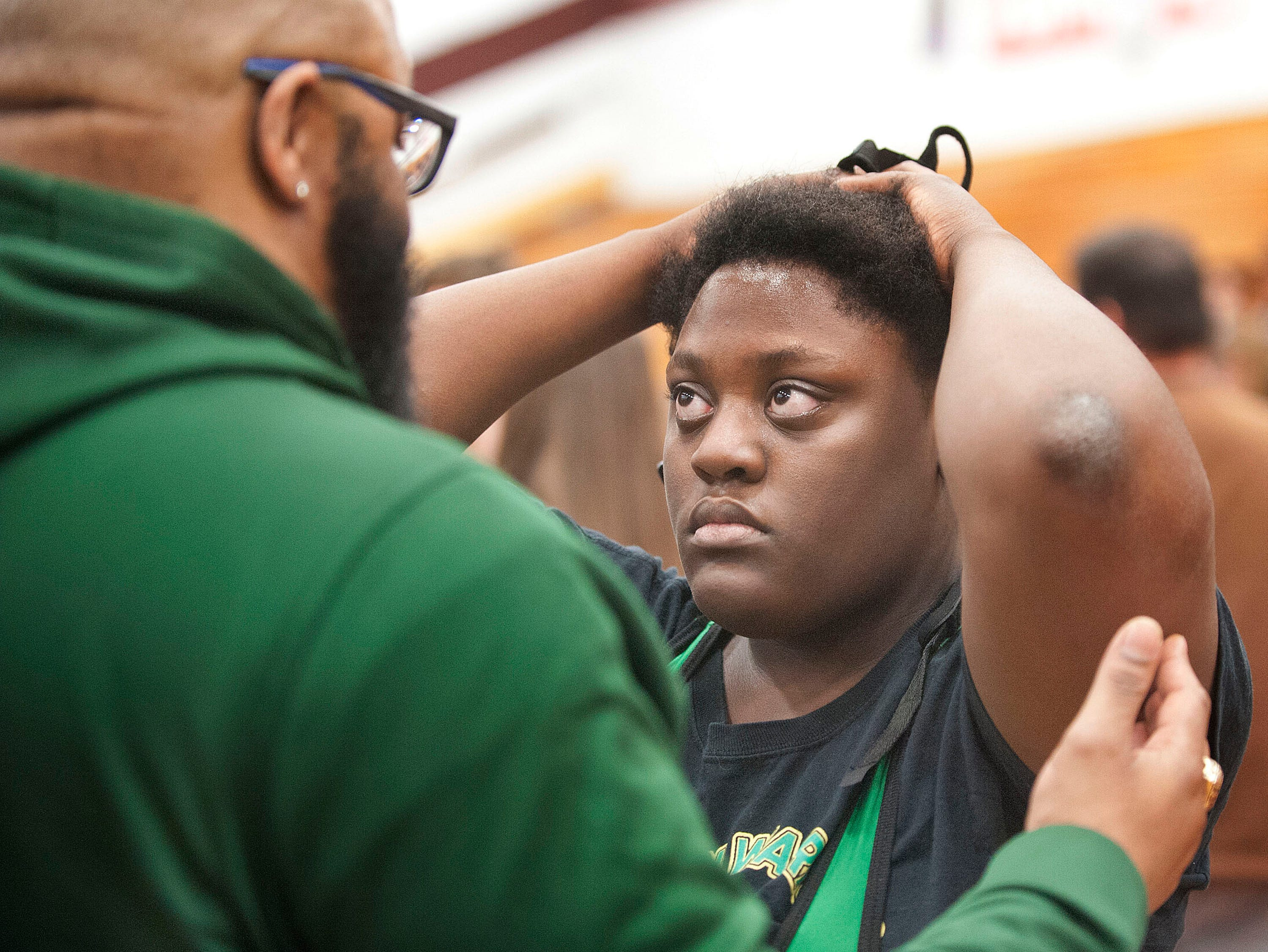 After the contest, Lokey listens, as Western wrestling assistant coach Torrey Shinholster explains some of the mistakes she made during the match.09 February 2019