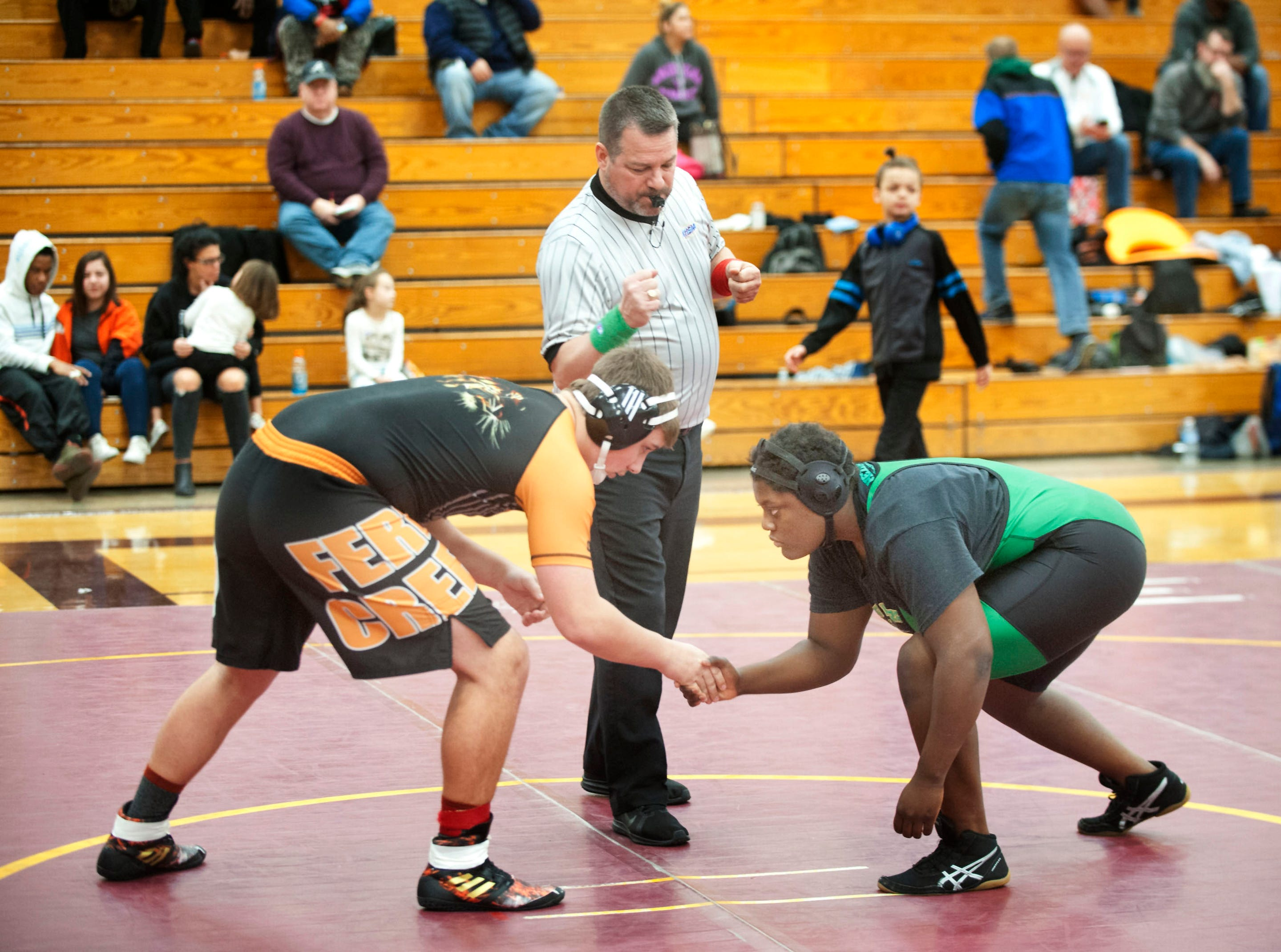 Fern Creek's Alex Martin, left, shakes hands with Lokey at the beginning of their 220 lb. class contest.09 February 2019
