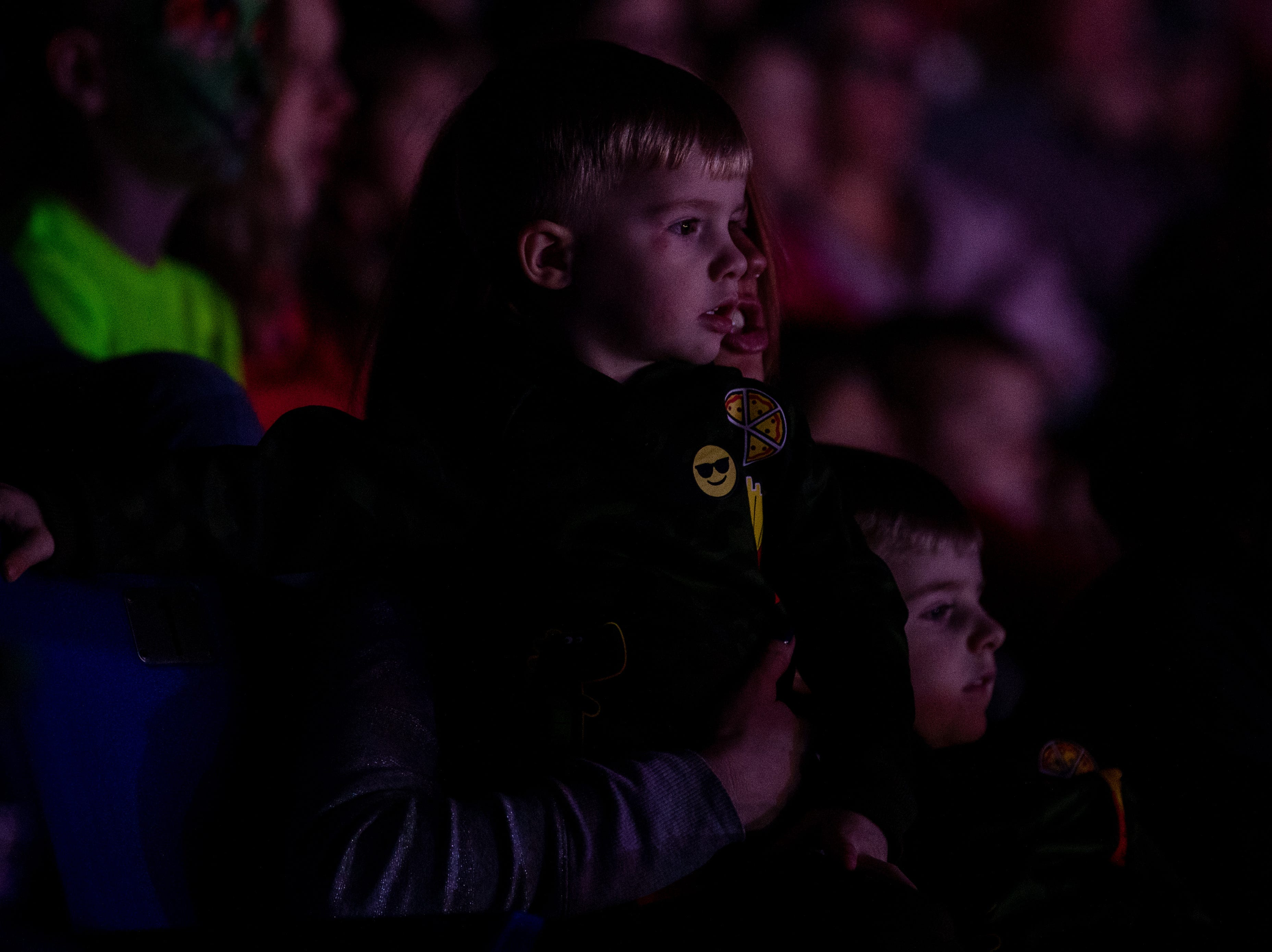 Focused on the performers spinning and flipping, a young boy is glued to the circus performance, Saturday, Feb. 9, 2019 in Louisville Ky.