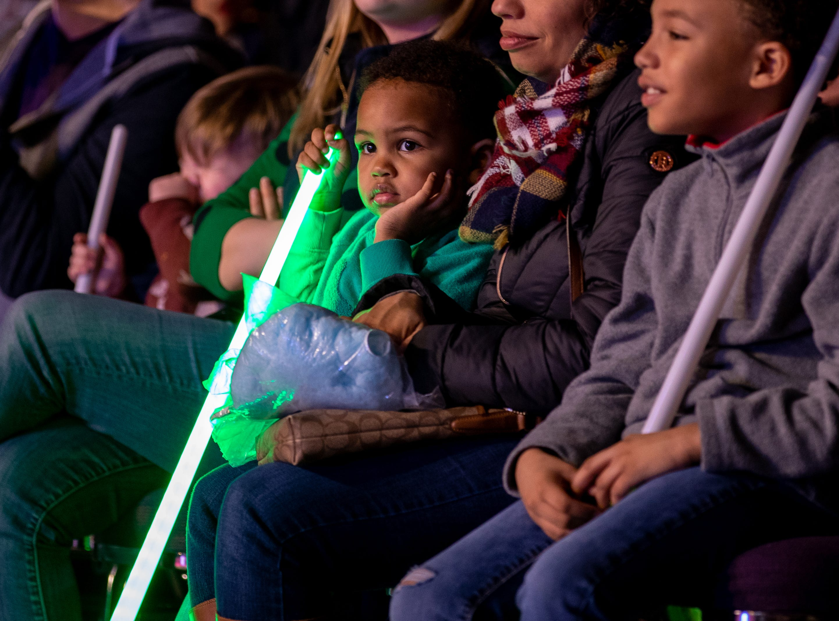 Young spectators in the crowd don their lightsabers waiting for more superhero action, Saturday, Feb. 9, 2019 in Louisville Ky.