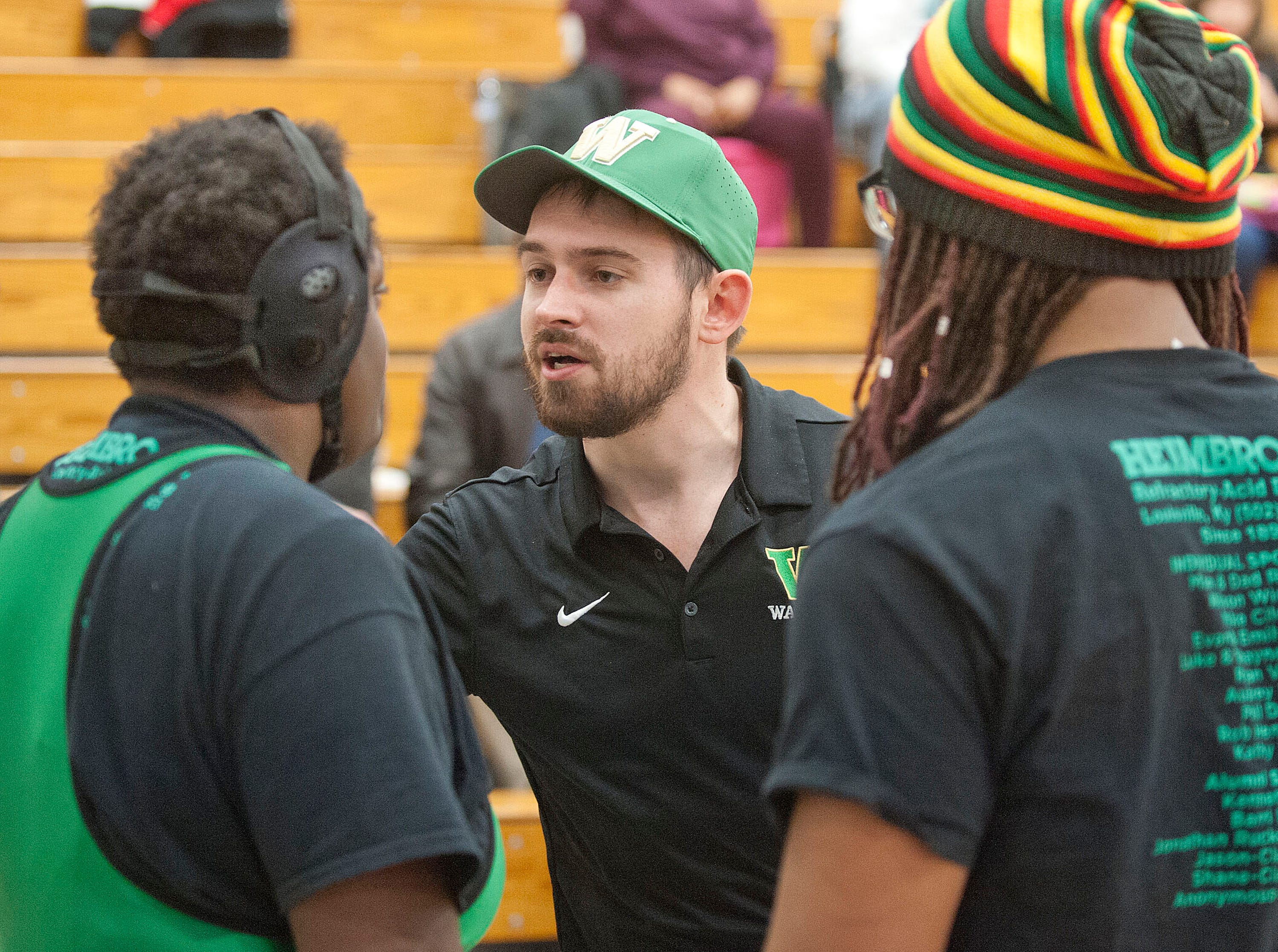 Western wrestling head coach Samuel Roberts gives his wrestler some last minute advice prior to the start of her match. At right is assistant coach Desean Stratton.09 February 2019