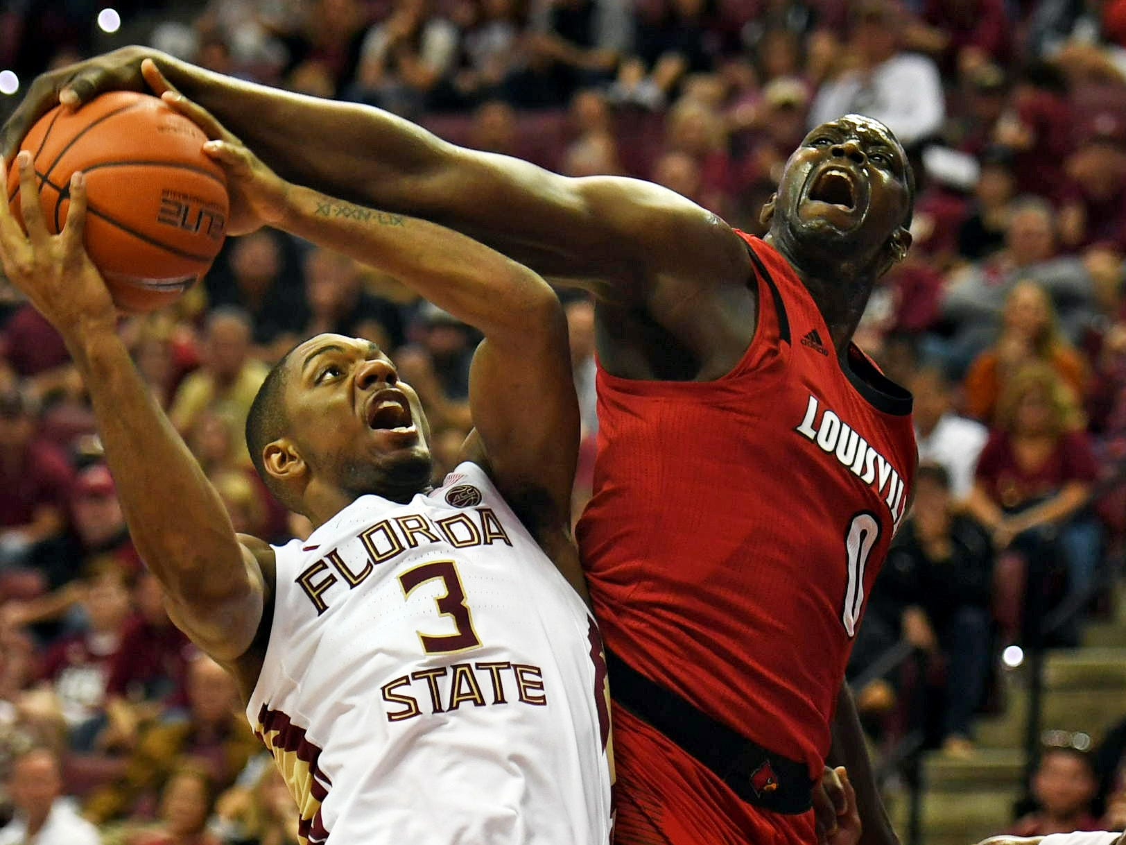 Louisville Cardinals forward Akoy Agau (0) is fouled as he tries to block the shot from Florida State Seminoles guard Trent Forrest (3) during the second half at Donald L. Tucker Center in Tallahassee, Florida, on Saturday, Feb. 9, 2019.
