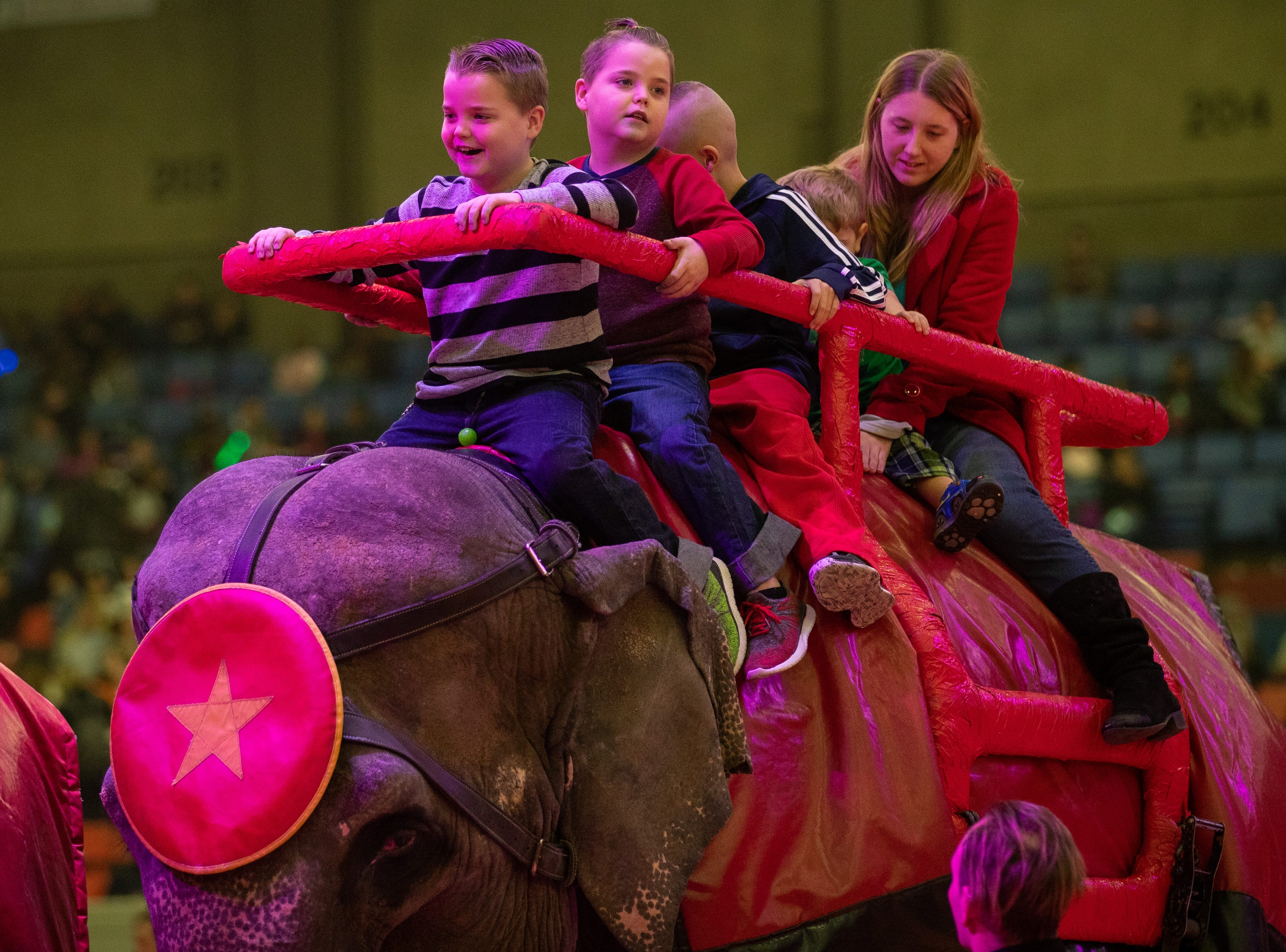 Kids and adults enjoy elephant rides during intermission of the Kosair Shrine Circus, Saturday, Feb. 9, 2019 in Louisville Ky.