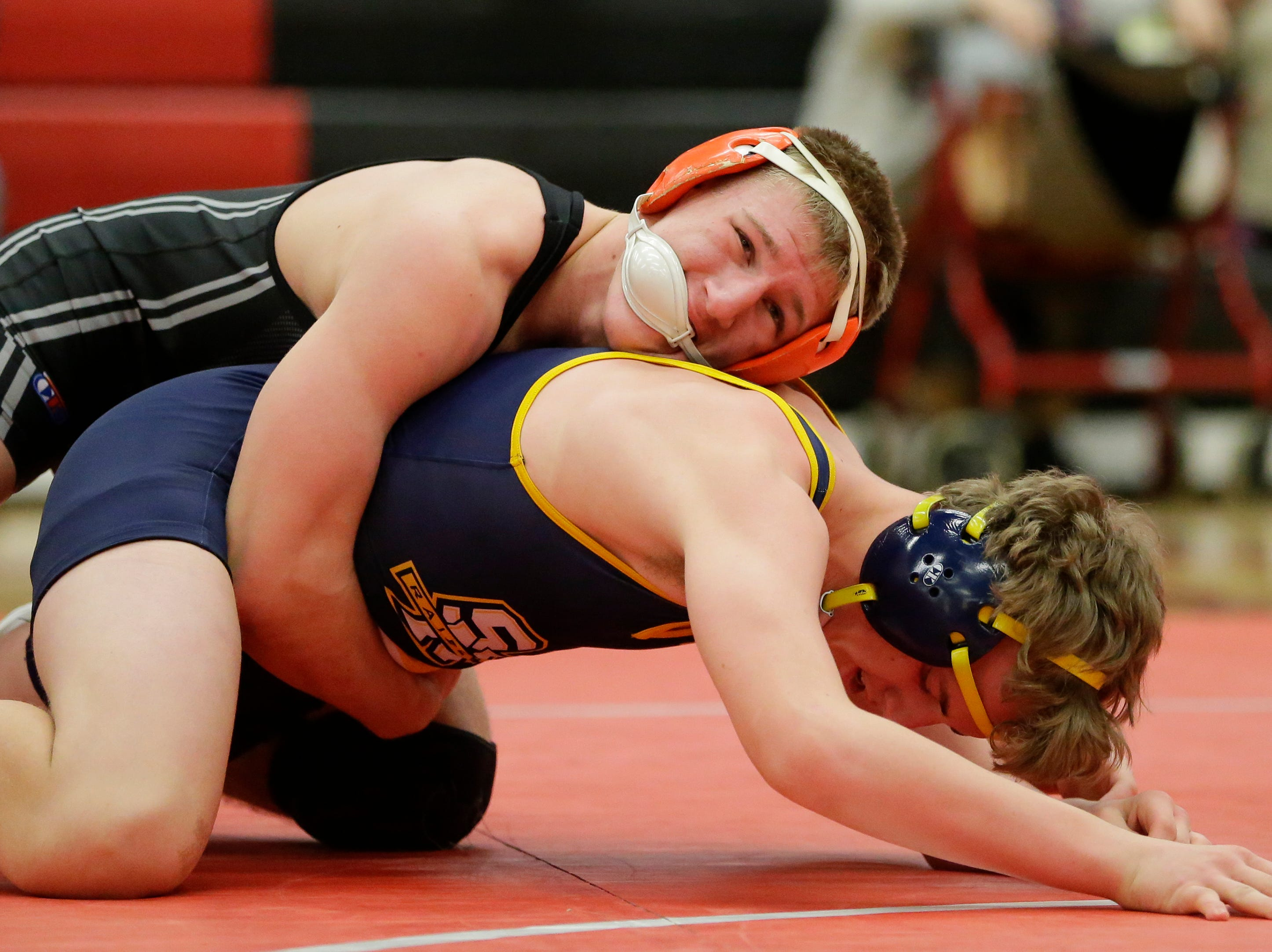 Plymouth's Josh Koll wrestles Sheboygan North's Kade Allen in the 160 weight class during the WIAA D1 Regionals at Manitowoc Lincoln High School Saturday, February 9, 2019, in Manitowoc, Wis. Joshua Clark/USA TODAY NETWORK-Wisconsin
