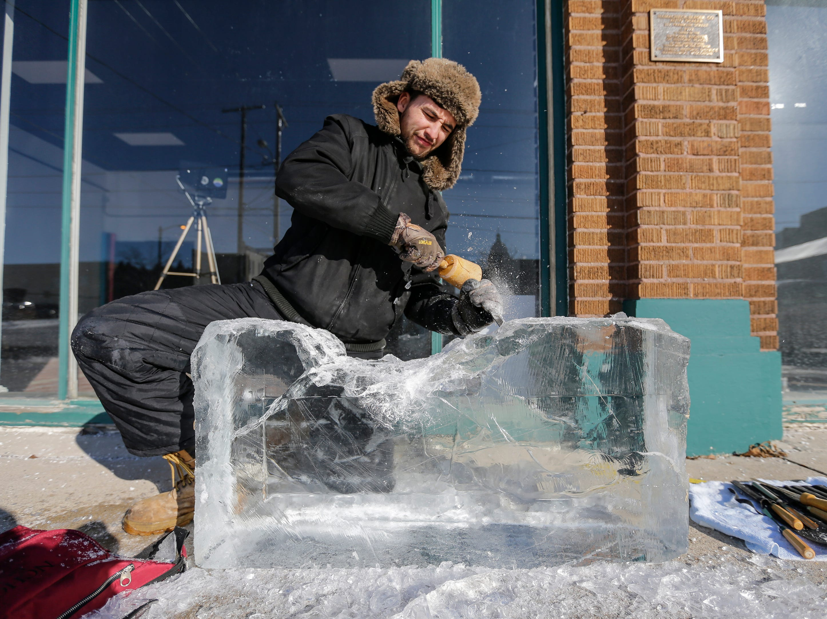 A.J. Jaeger works on an ice sculpture during Winter Fest Saturday, February 9, 2019, in Manitowoc, Wis. Joshua Clark/USA TODAY NETWORK-Wisconsin