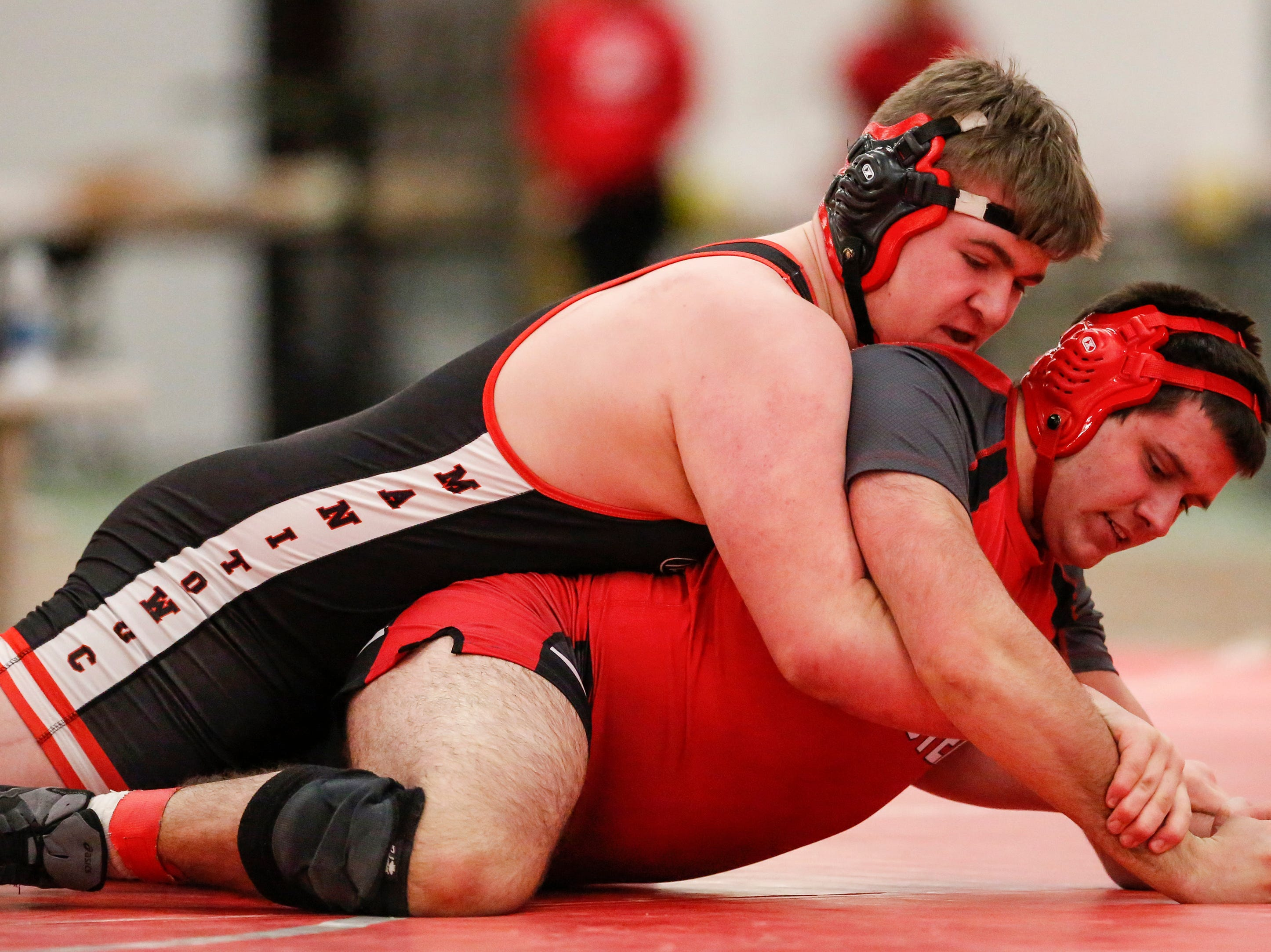 Manitowoc Lincoln's Gryffin Jones wrestles Homestead's Devin Klein in the 285 weight class during the WIAA D1 Regionals at Manitowoc Lincoln High School Saturday, February 9, 2019, in Manitowoc, Wis. Joshua Clark/USA TODAY NETWORK-Wisconsin