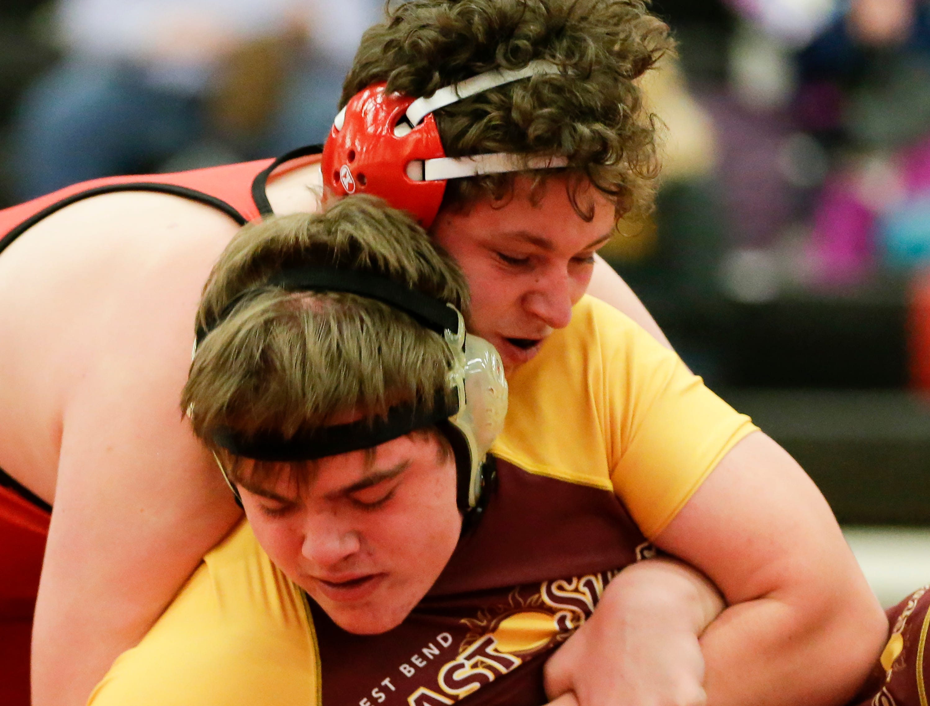 Sheboygan South's Mitchell Prueser wrestles West Bend East's Dorn Champagne in the 220 weight class during the WIAA D1 Regionals at Manitowoc Lincoln High School Saturday, February 9, 2019, in Manitowoc, Wis. Joshua Clark/USA TODAY NETWORK-Wisconsin
