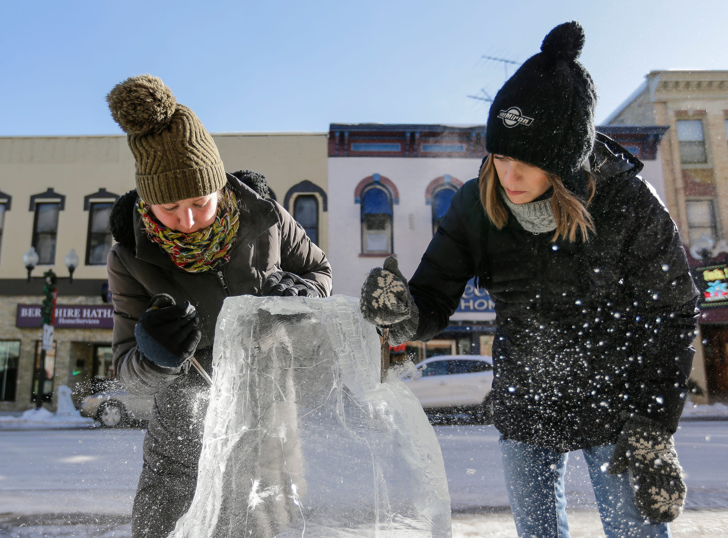 Erin LaBonte, left, and Cassie Hebert work on an ice sculpture during Winter Fest Saturday, February 9, 2019, in Manitowoc, Wis. Joshua Clark/USA TODAY NETWORK-Wisconsin