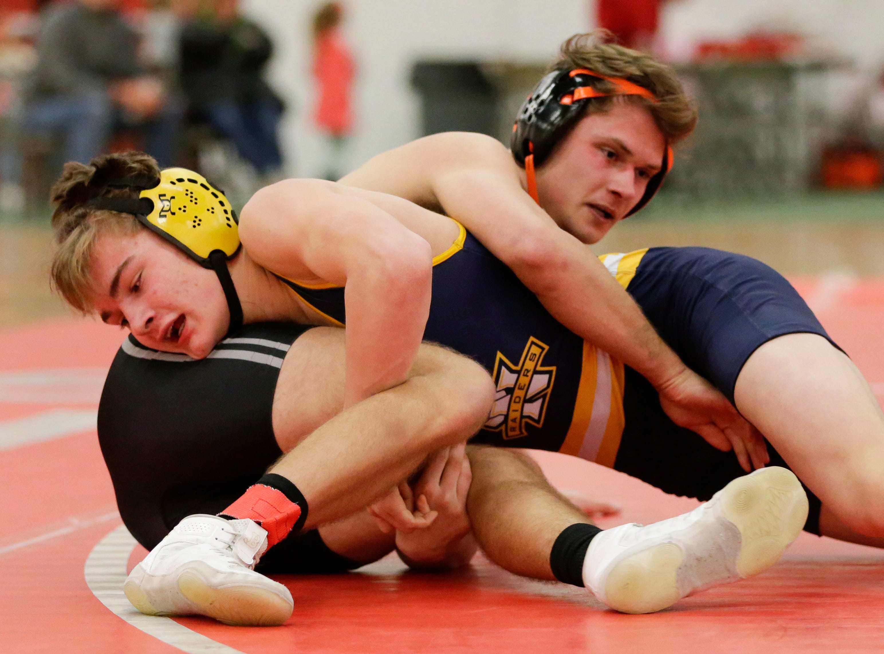 Sheboygan North's Zane Tinkle wrestles Plymouth's Joe Mertes in the 152 weight class during the WIAA D1 Regionals at Manitowoc Lincoln High School Saturday, February 9, 2019, in Manitowoc, Wis. Joshua Clark/USA TODAY NETWORK-Wisconsin