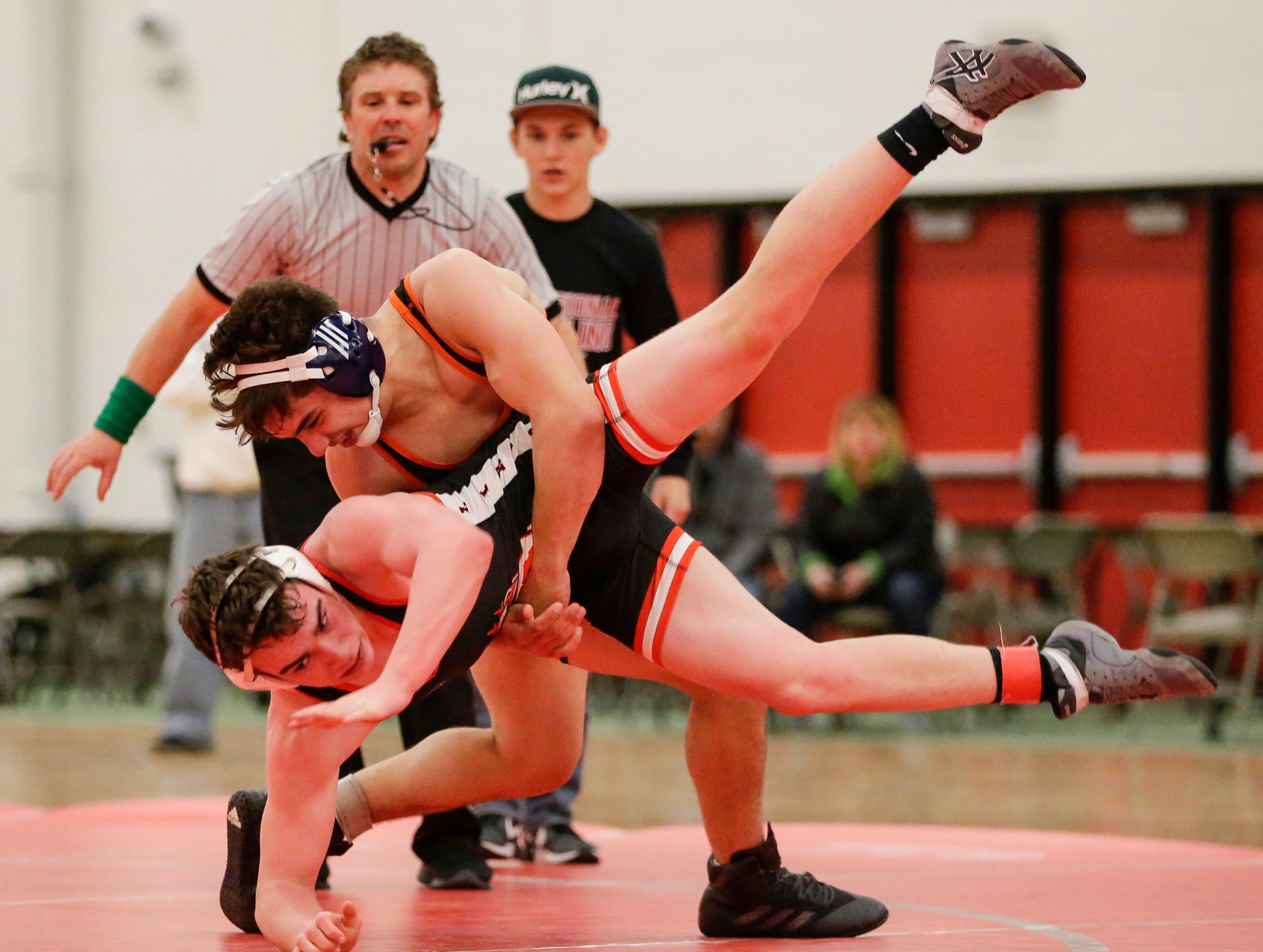 Cedarburg's Benjamin Erickson wrestles Manitowoc Lincoln's Trevor DeBruin in the 160 weight class during the WIAA D1 Regionals at Manitowoc Lincoln High School Saturday, February 9, 2019, in Manitowoc, Wis. Joshua Clark/USA TODAY NETWORK-Wisconsin