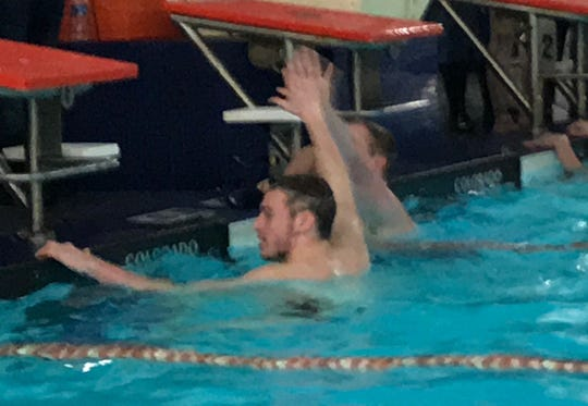 Lexington's Cayman Eichler and Galion's Caleb Strack give each other a high-five after they finished first and second, respectively, in the 100 backstroke at Saturday's Division II sectional swim meet.