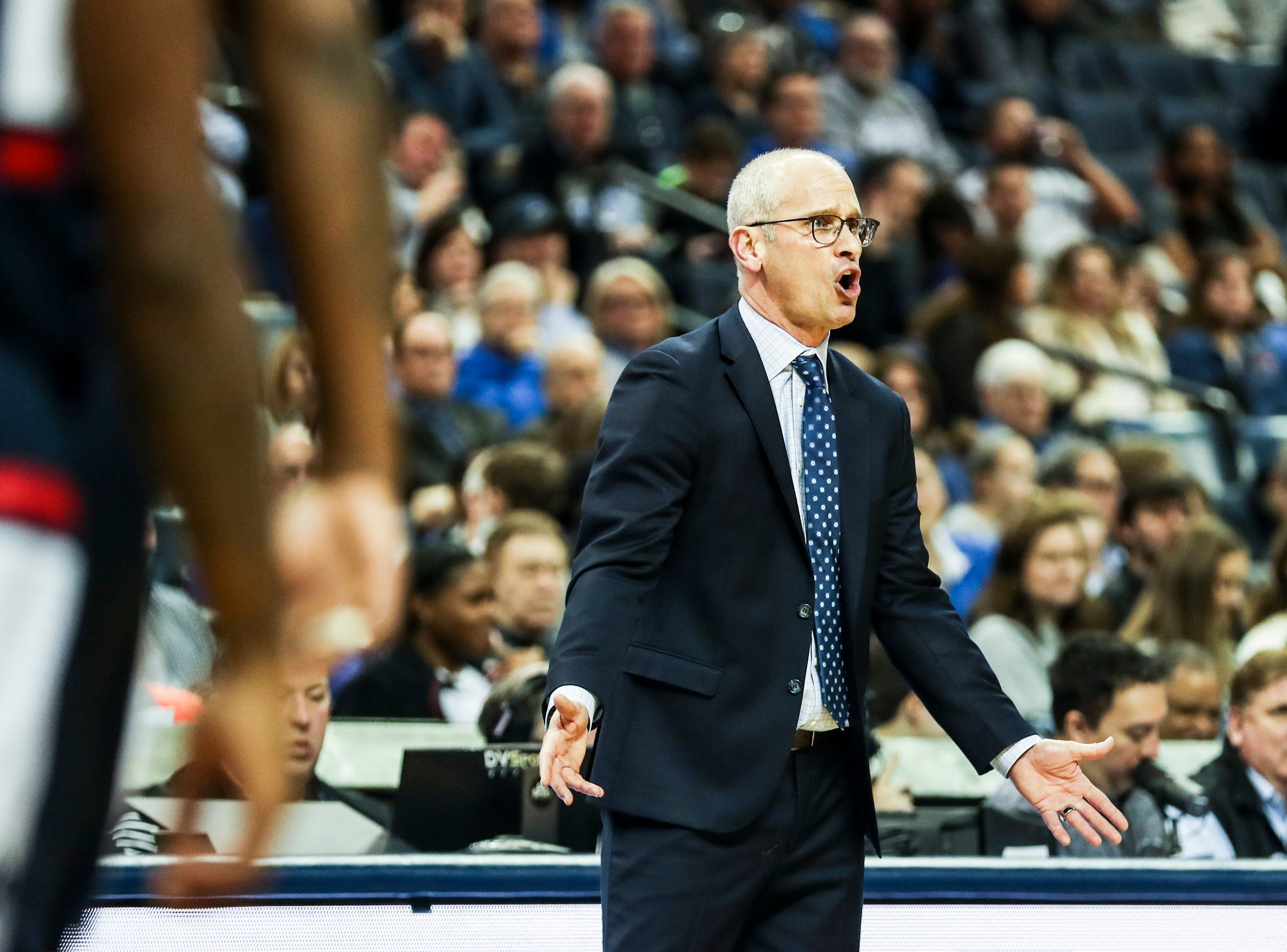 February 10, 2019 - Connecticut's head coach, Dan Hurley, yells out to his players during Sunday's game versus Connecticut at the FedExForum.