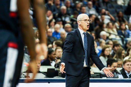 Connecticut coach Dan Hurley yells out to his players Sunday.