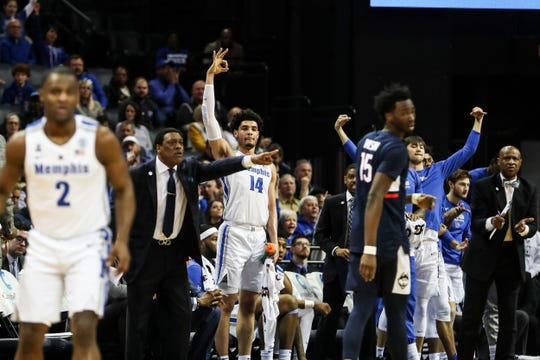 Memphis players celebrate during Sunday's game against Connecticut at FedExForum.