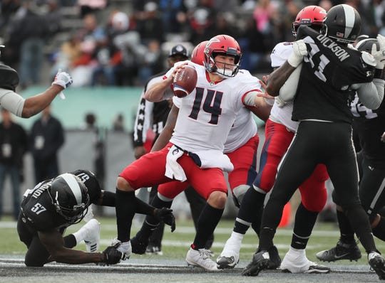 Memphis Express quarterback Christian Hackenberg is sacked by Birmingham Iron linebacker Jonathan Massaquoi during their game at Legion Field in Birmingham, Ala. on Sunday, Feb. 10, 2019.