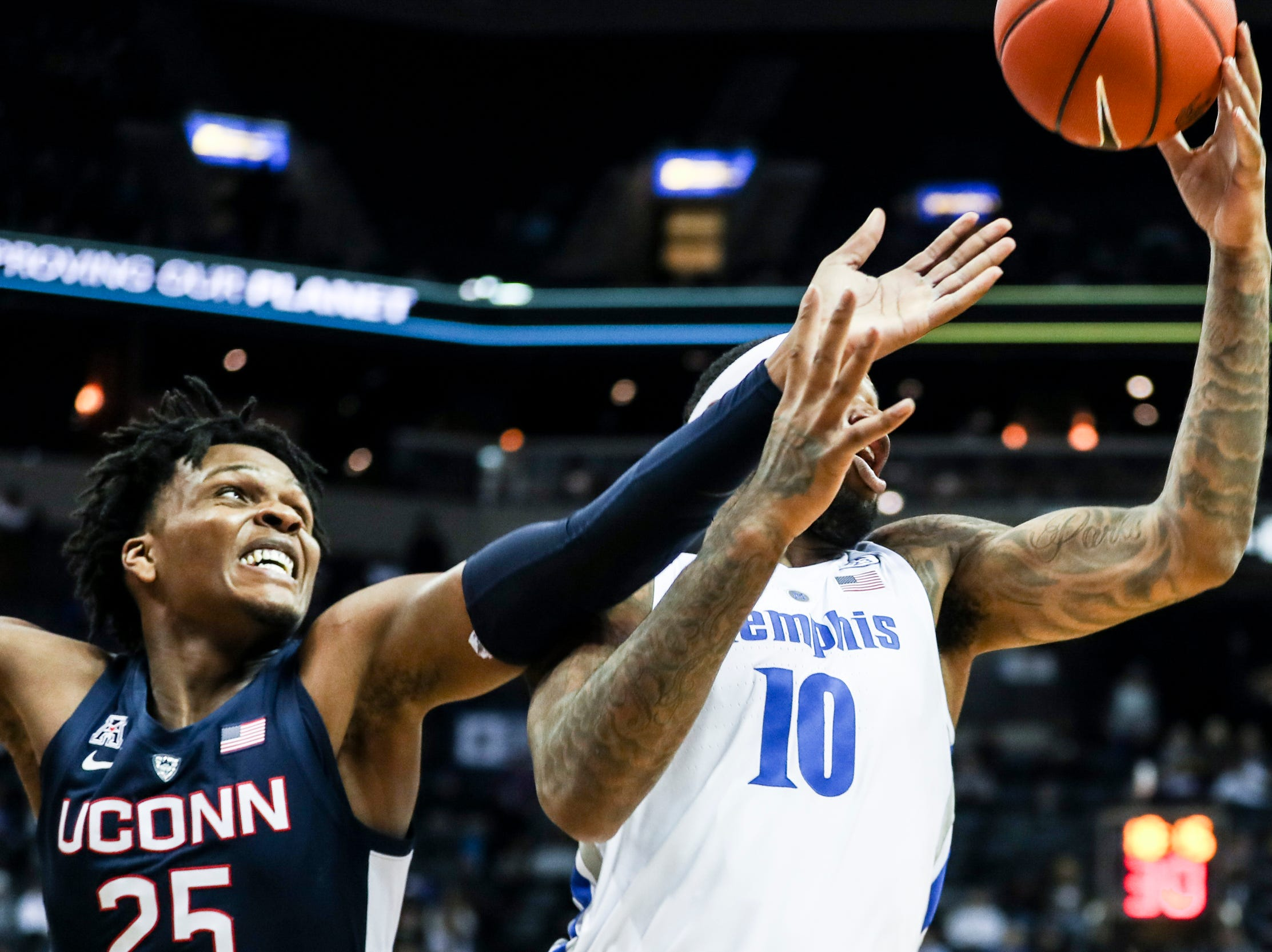 February 10, 2019 - Connecticut's Josh Carlton, left, and Memphis' Mike Parks Jr. work for the ball during Sunday's game versus Connecticut at the FedExForum.