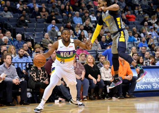 New Orleans Pelicans forward Darius Miller (21) handles the ball against Memphis Grizzlies guard Mike Conley (11) during the first half of an NBA basketball game Saturday, Feb. 9, 2019, in Memphis, Tenn. (AP Photo/Brandon Dill)