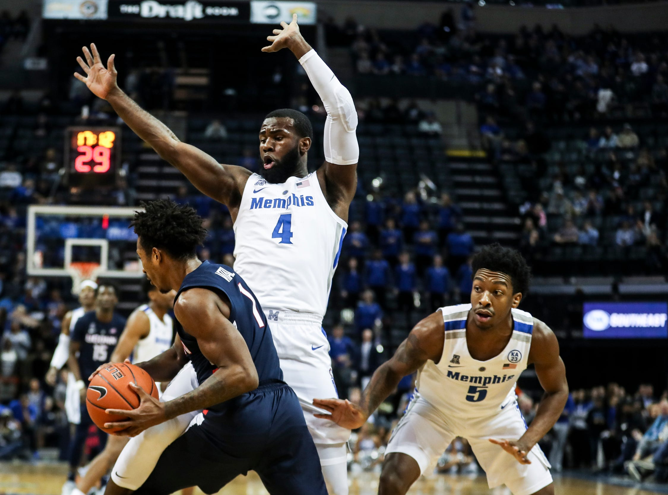 February 10, 2019 - Memphis' Raynere Thornton, center, and Kareem Brewton Jr., right, defend Connecticut's Christian Vital during Sunday's game versus Connecticut at the FedExForum.