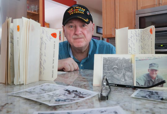 Gary Weckwerth is surrounded by photos and letters in his Glendale home on Feb. 5 from his childhood friend Wayne R. Thomas, who was killed in Vietnam three days after his 20th birthday in 1969.