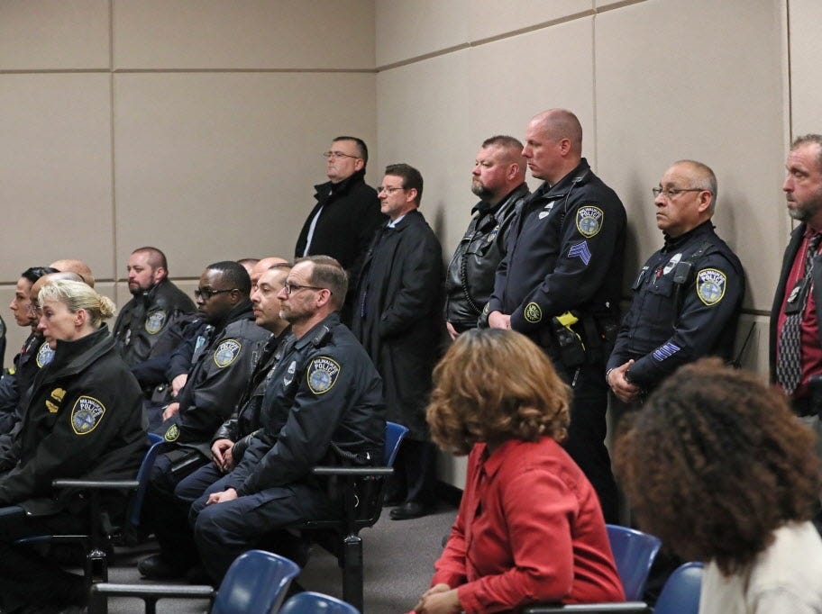 Milwaukee police officers in the courtroom watched the proceedings as Jordan P. Fricke appears in intake court  on Sunday, charged in the murder of Milwaukee Police Officer Matthew Rittner.