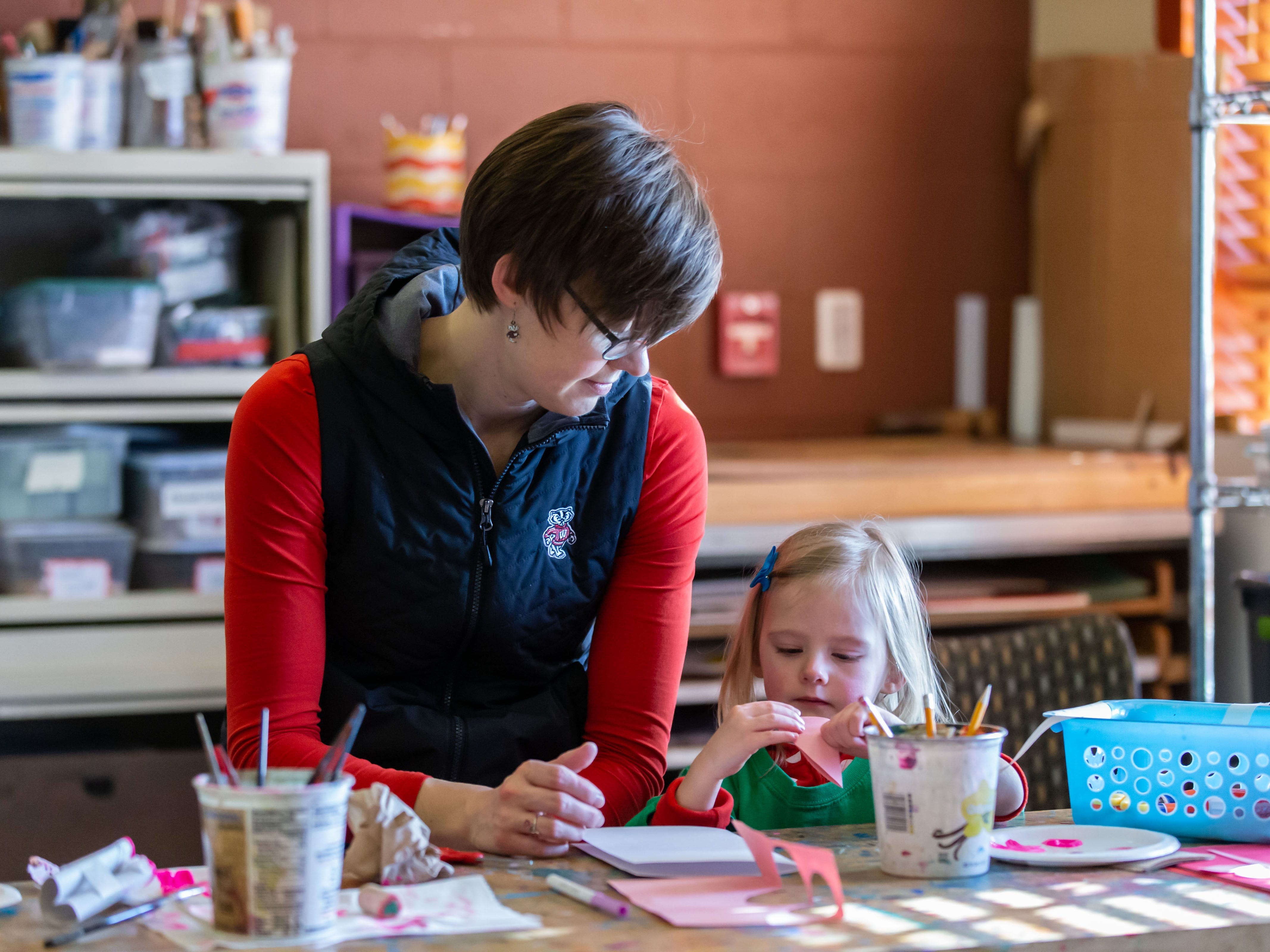 Two-year-old Eva Aasen of Pewaukee creates a Valentine's Day card with her mother Kristin during the Free Family Art Workshop at the Sharon Lynne Wilson Center for the Arts in Brookfield on Saturday, Feb. 9, 2019. The free art workshops are held from 10 a.m. to noon on the second Saturday of each month. For more info visit wilson-center.com/classes.